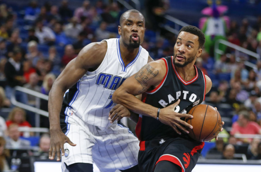 Feb 3, 2017; Orlando, FL, USA; Toronto Raptors guard Norman Powell (24) dribbles the ball past Orlando Magic forward Serge Ibaka (7) during the second quarter of an NBA basketball game at Amway Center. Mandatory Credit: Reinhold Matay-USA TODAY Sports