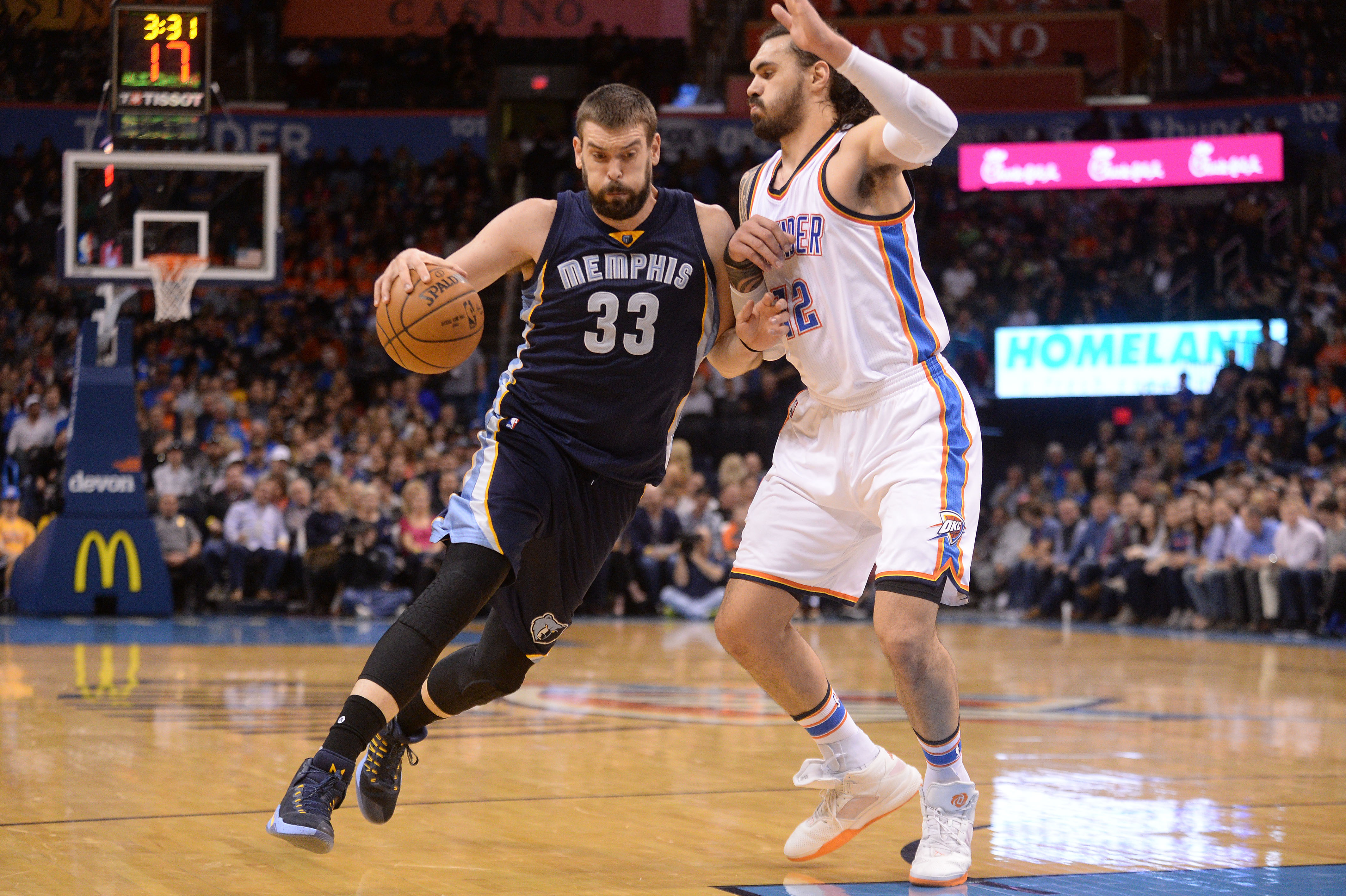 Feb 3, 2017; Oklahoma City, OK, USA; Memphis Grizzlies center Marc Gasol (33) drives to the basket in front of Oklahoma City Thunder center Steven Adams (12) during the second quarter at Chesapeake Energy Arena. Mandatory Credit: Mark D. Smith-USA TODAY Sports
