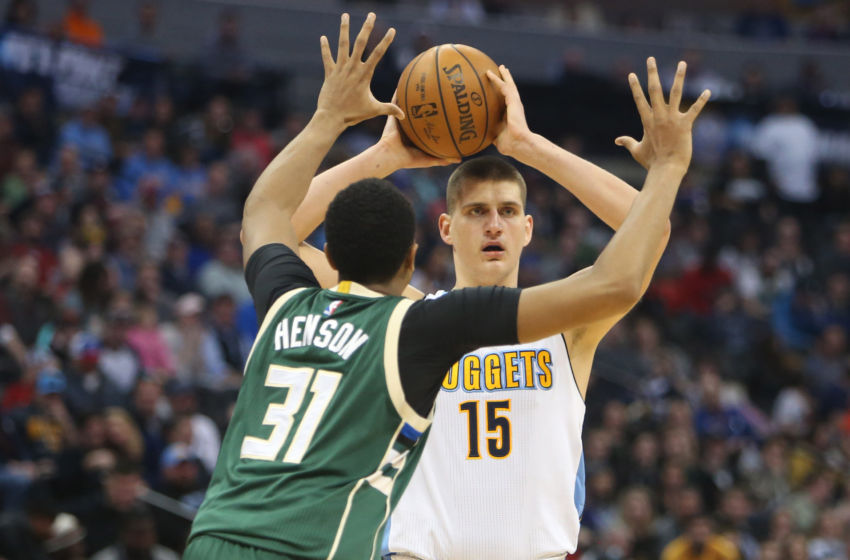 Feb 3, 2017; Denver, CO, USA; Denver Nuggets forward Nikola Jokic (15) looks to pass the ball against Milwaukee Bucks center John Henson (31) during the second half at Pepsi Center. The Nuggets won 121-117. Mandatory Credit: Chris Humphreys-USA TODAY Sports
