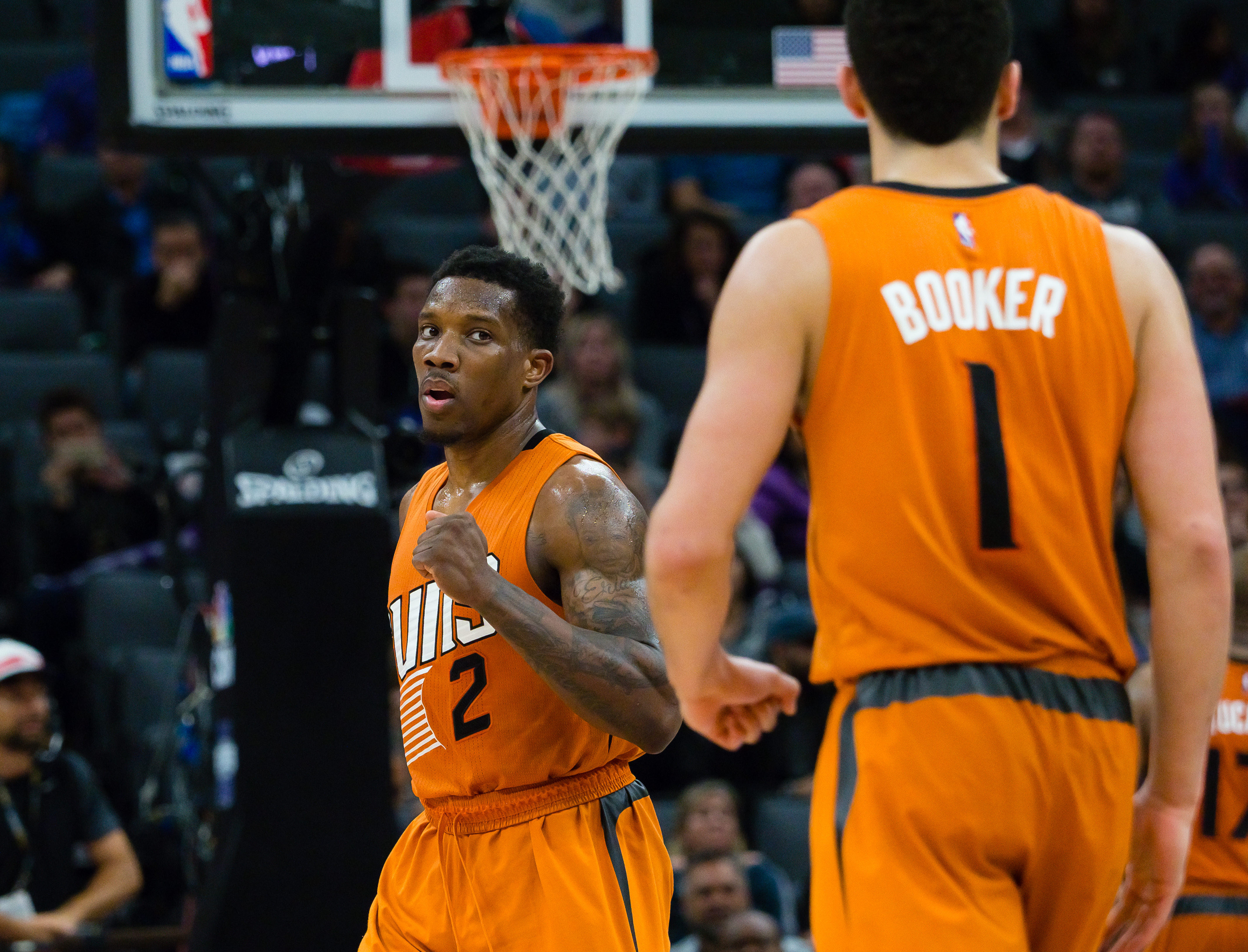 Feb 3, 2017; Sacramento, CA, USA; Phoenix Suns guard Eric Bledsoe (2) celebrates towards guard Devin Booker (1) after a play against the Sacramento Kings during the fourth quarter at Golden 1 Center. The Phoenix Suns defeated the Sacramento Kings 105-103. Mandatory Credit: Kelley L Cox-USA TODAY Sports