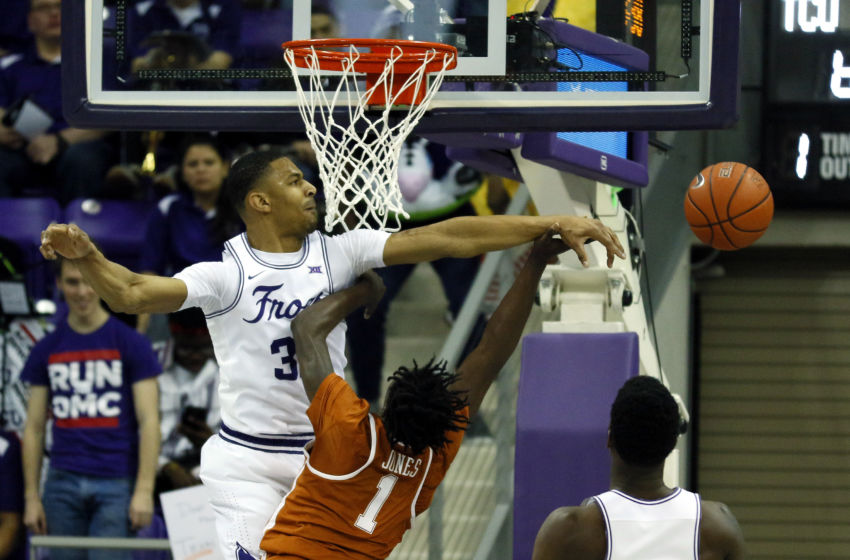 Feb 4, 2017; Fort Worth, TX, USA; TCU Horned Frogs forward Karviar Shepherd (32) is called for the foul after blocking the shot of Texas Longhorns guard Andrew Jones (1) during the second half at Ed and Rae Schollmaier Arena. TCU won 78-63. Mandatory Credit: Ray Carlin-USA TODAY Sports