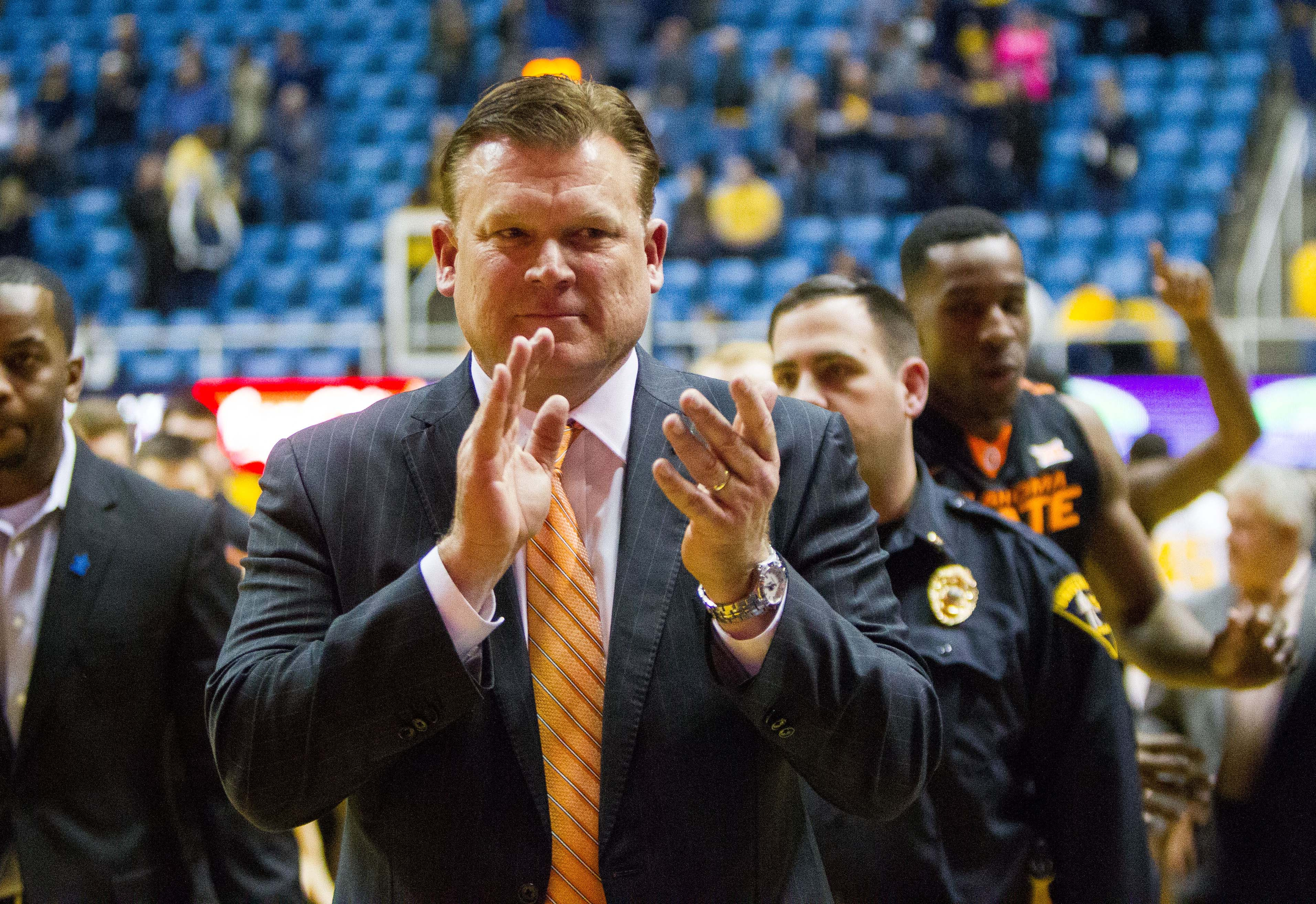 9858359-ncaa-basketball-oklahoma-state-at-west-virginia