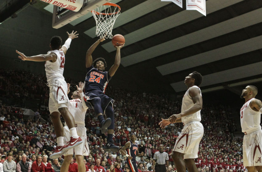 Feb 4, 2017; Tuscaloosa, AL, USA; Auburn Tigers forward Anfernee McLemore (24) goes to the basket during the first half at Coleman Coliseum against Alabama Crimson Tide . The Tigers defeated the Tide 82-77. Mandatory Credit: Marvin Gentry-USA TODAY Sports