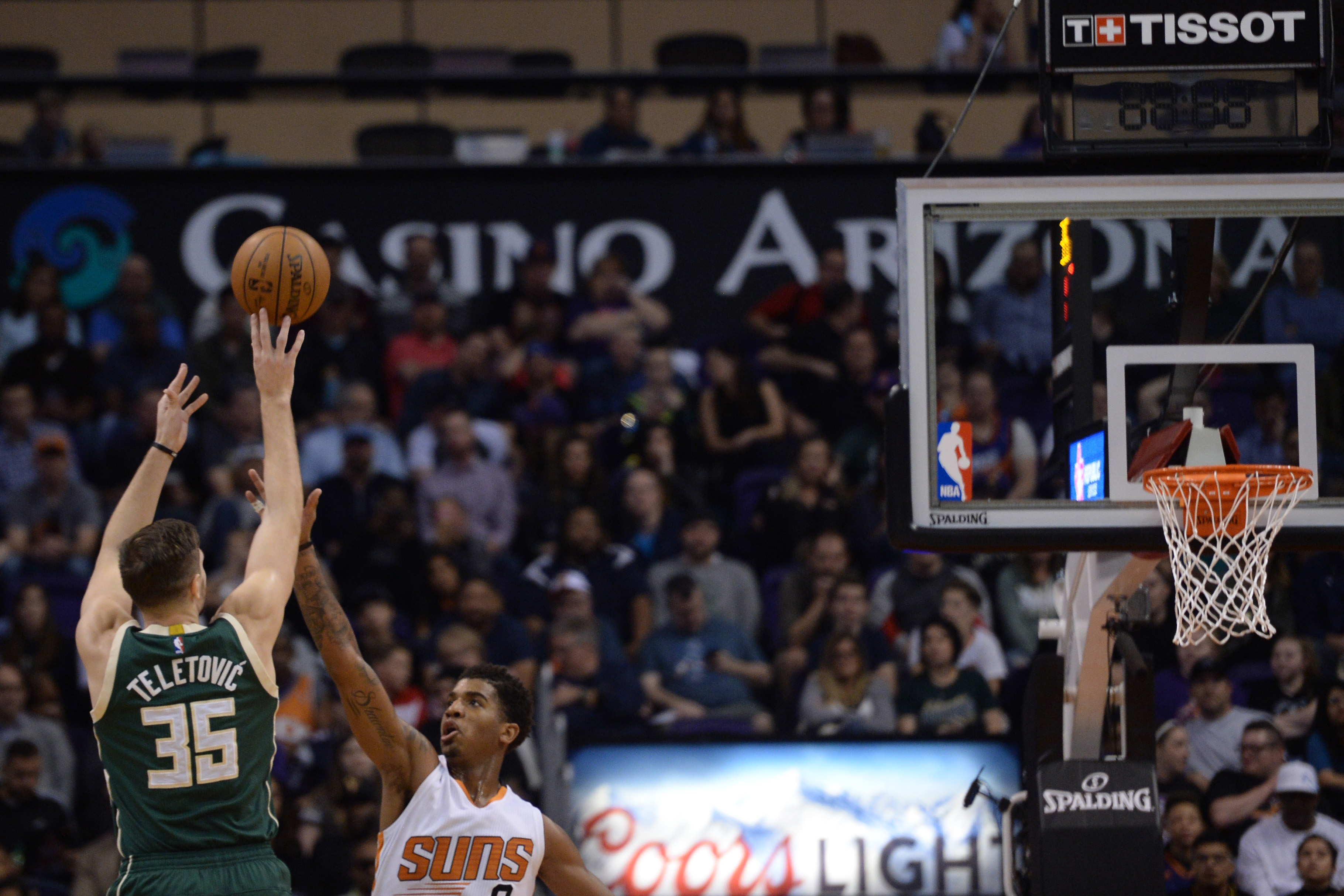 Feb 4, 2017; Phoenix, AZ, USA; Milwaukee Bucks forward Mirza Teletovic (35) shoots over Phoenix Suns forward Marquese Chriss (0) during the second half at Talking Stick Resort Arena. The Bucks won 137-112. Mandatory Credit: Joe Camporeale-USA TODAY Sports