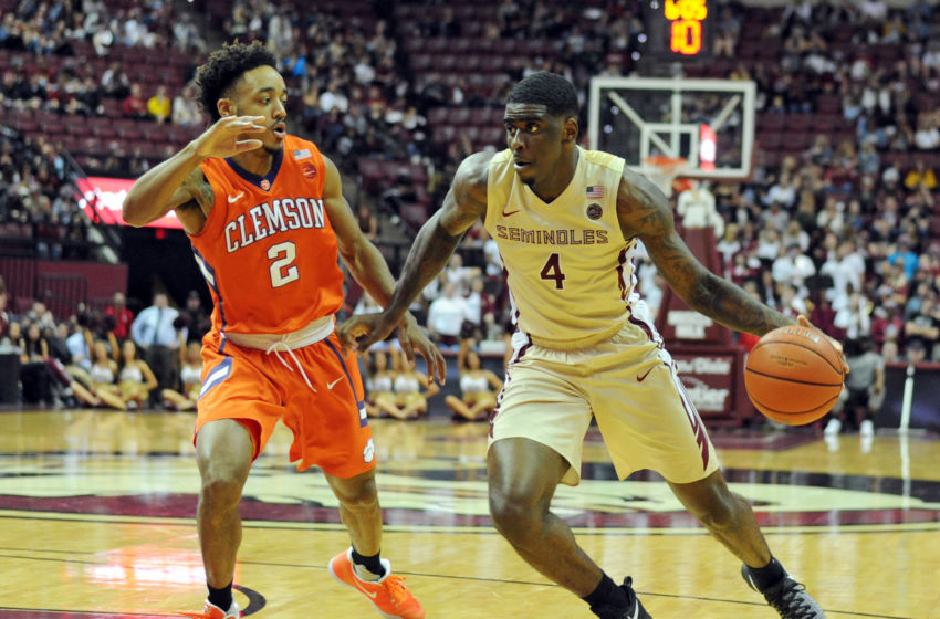 Feb 5, 2017; Tallahassee, FL, USA; Florida State Seminoles guard Dwayne Bacon (4) moves the ball around Clemson Tigers guard Marcquise Reed (2) during the second half at the Donald L. Tucker Center. Mandatory Credit: Melina Vastola-USA TODAY Sports