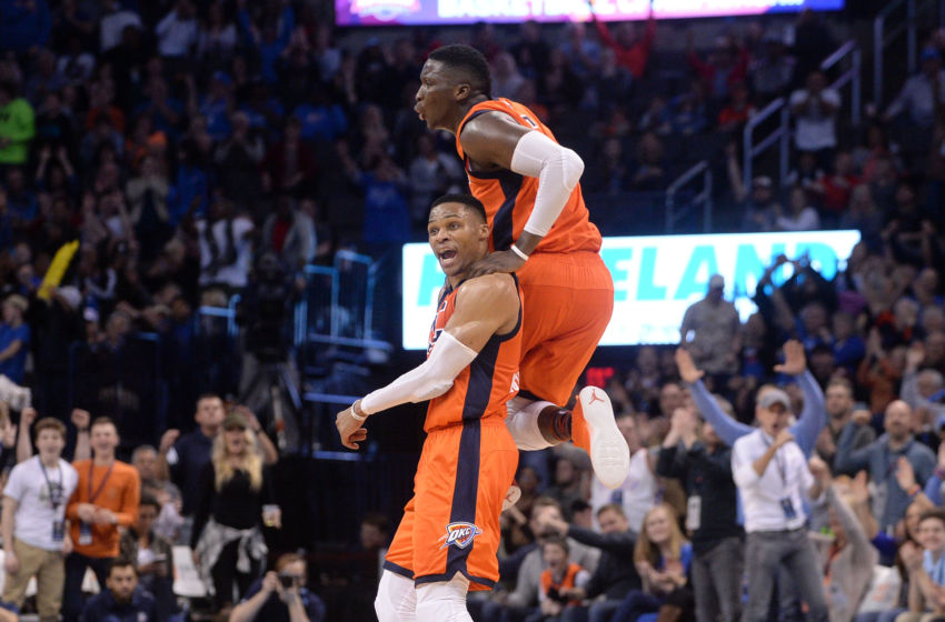 Feb 5, 2017; Oklahoma City, OK, USA; Oklahoma City Thunder guard Russell Westbrook (0) and Oklahoma City Thunder guard Victor Oladipo (5) react after a play against the Portland Trail Blazers during the fourth quarter at Chesapeake Energy Arena. Mandatory Credit: Mark D. Smith-USA TODAY Sports