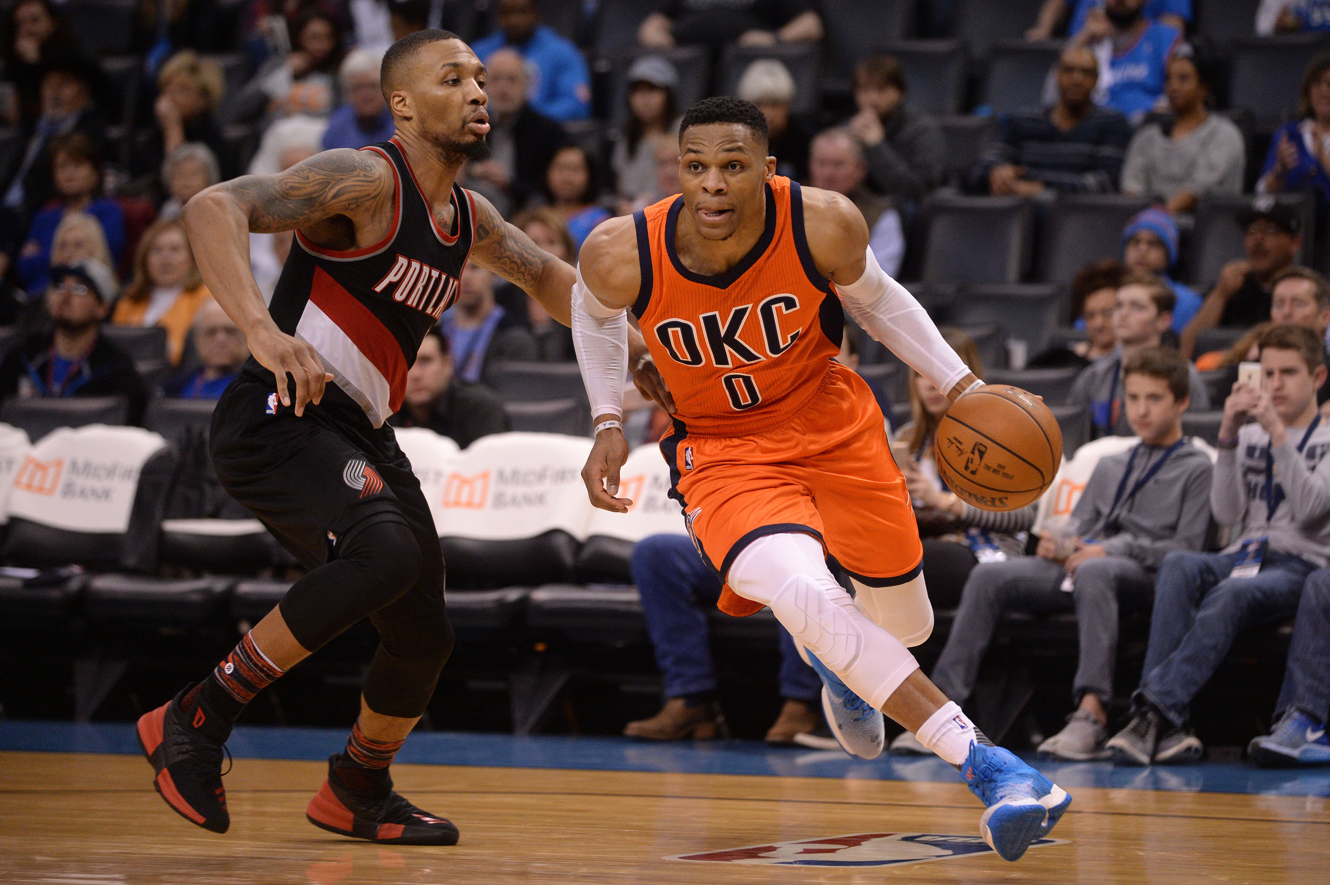 Feb 5, 2017; Oklahoma City, OK, USA; Oklahoma City Thunder guard Russell Westbrook (0) drives to the basket in front of Portland Trail Blazers guard Damian Lillard (0) during the third quarter at Chesapeake Energy Arena. Mandatory Credit: Mark D. Smith-USA TODAY Sports