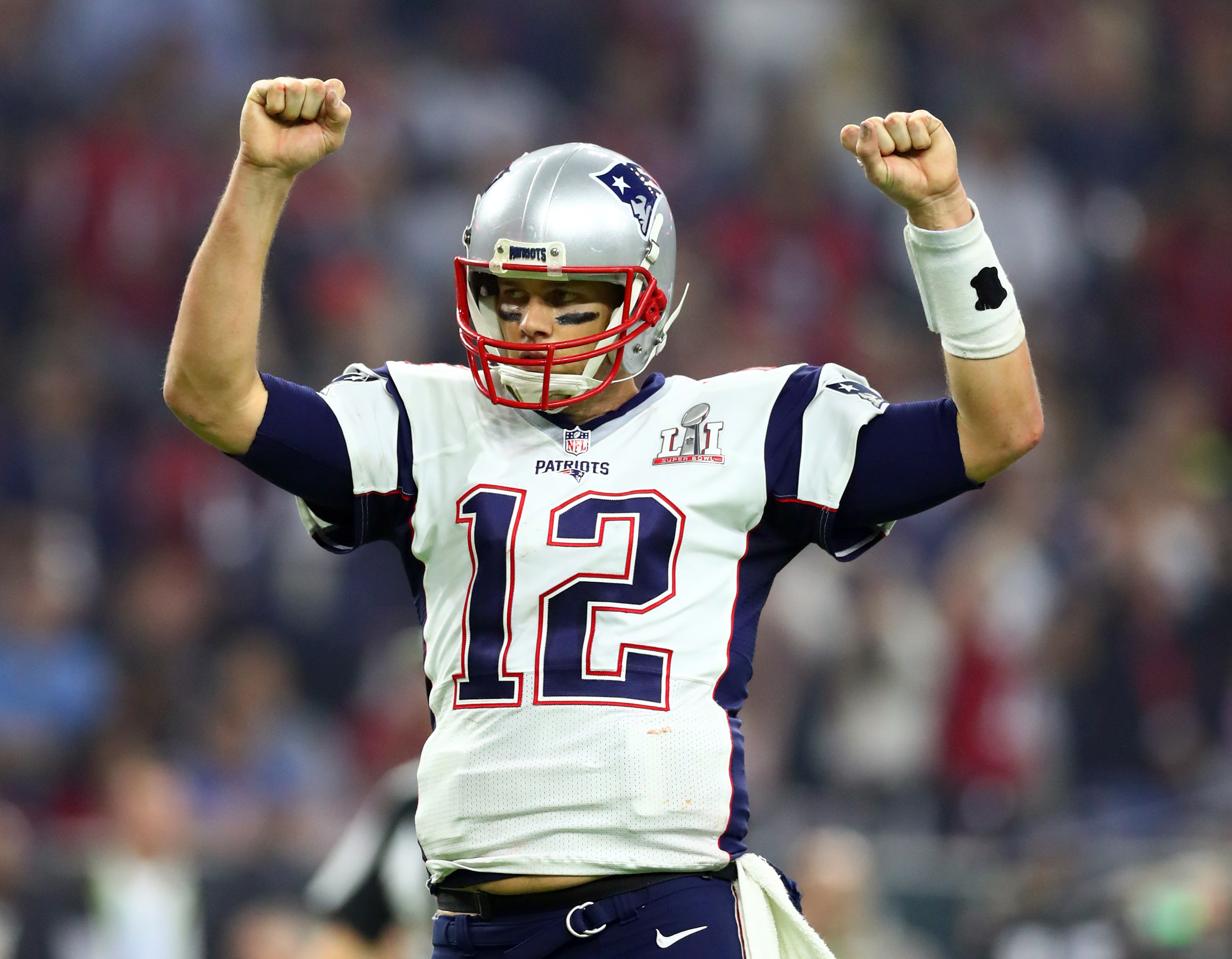 Feb 5, 2017; Houston, TX, USA; New England Patriots quarterback Tom Brady (12) celebrates a two-point conversion against the Atlanta Falcons in the fourth quarter during Super Bowl LI at NRG Stadium. Mandatory Credit: Mark J. Rebilas-USA TODAY Sports