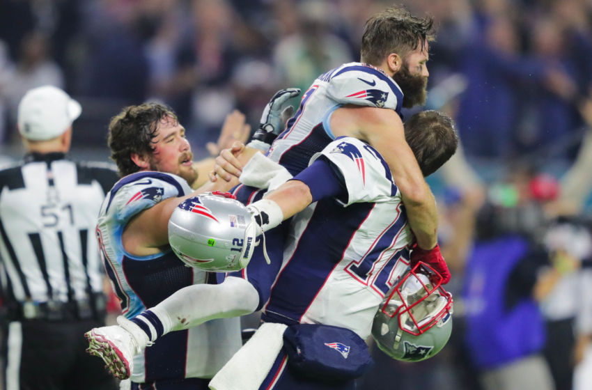 Feb 5, 2017; Houston, TX, USA; New England Patriots wide receiver Julian Edelman (11) and quarterback Tom Brady (12) celebrate their win over Atlanta Falcons during Super Bowl LI at NRG Stadium. The Patriots won 34-28. Mandatory Credit: Dan Powers-USA TODAY Sports