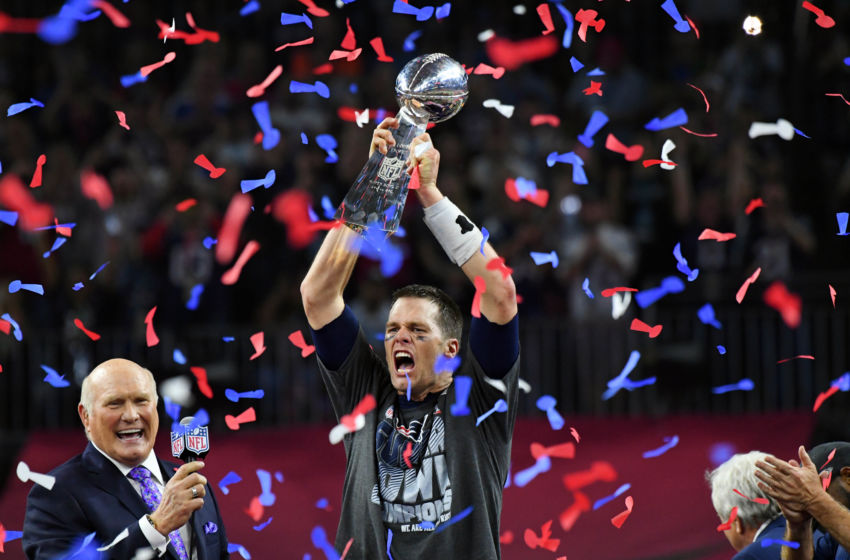 Feb 5, 2017; Houston, TX, USA; New England Patriots quarterback Tom Brady celebrates with the Vince Lombardi Trophy after defeating the Atlanta Falcons 34-38 in Super Bowl LI at NRG Stadium. Mandatory Credit: Robert Deutsch-USA TODAY Sports