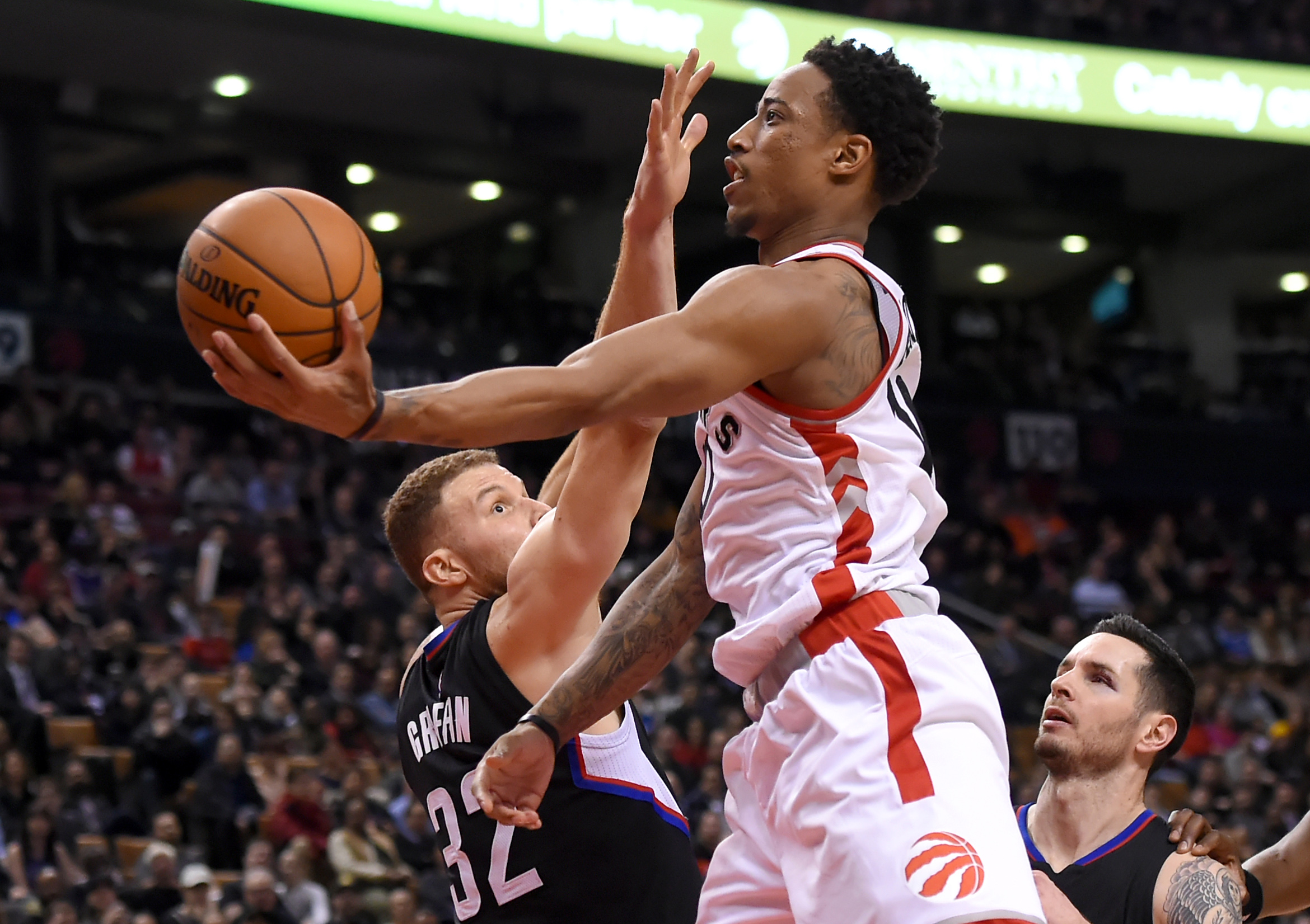 Feb 6, 2017; Toronto, Ontario, CAN; Toronto Raptors guard DeMar DeRozan (10) shoots the ball past Los Angeles Clippers forward Blake Griffin (32) in the fourth quarter at Air Canada Centre. Mandatory Credit: Dan Hamilton-USA TODAY Sports