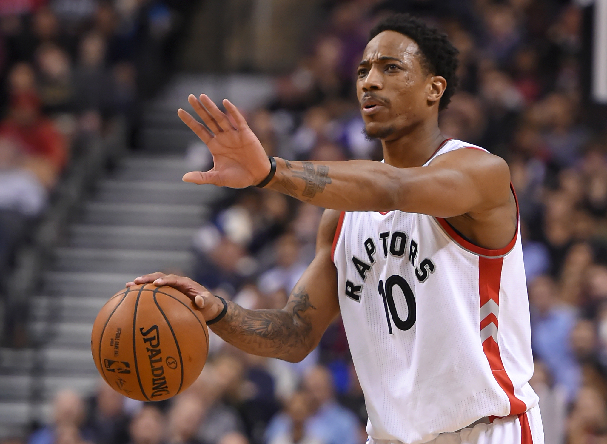 Feb 6, 2017; Toronto, Ontario, CAN; Toronto Raptors guard DeMar DeRozan (10) gestures from the court during the fourth quarter against the Los Angeles Clippers at Air Canada Centre. The Raptors won 118-109. Mandatory Credit: Dan Hamilton-USA TODAY Sports