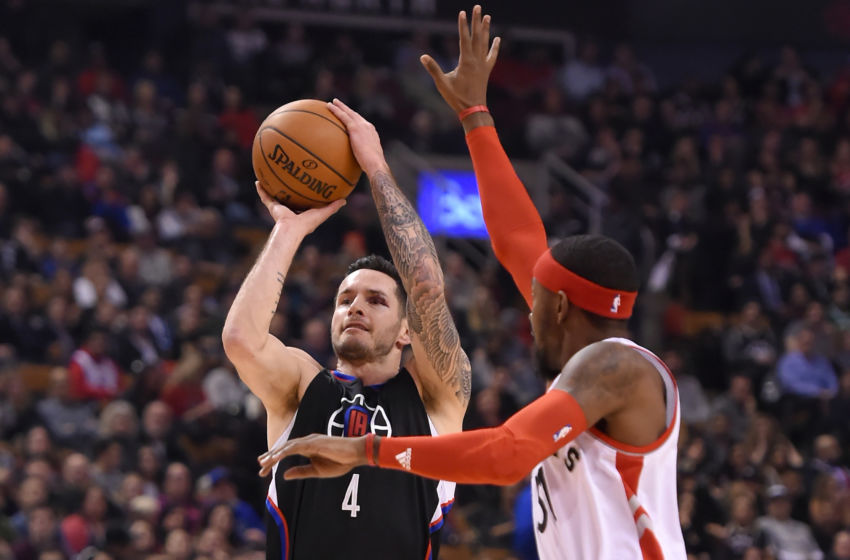 Feb 6, 2017; Toronto, Ontario, CAN; Los Angeles Clippers guard J.J. Redick (4) shoots the ball past Toronto Raptors guard Terrence Ross (31) in the first half at Air Canada Centre. The Raptors won 118-109. Mandatory Credit: Dan Hamilton-USA TODAY Sports