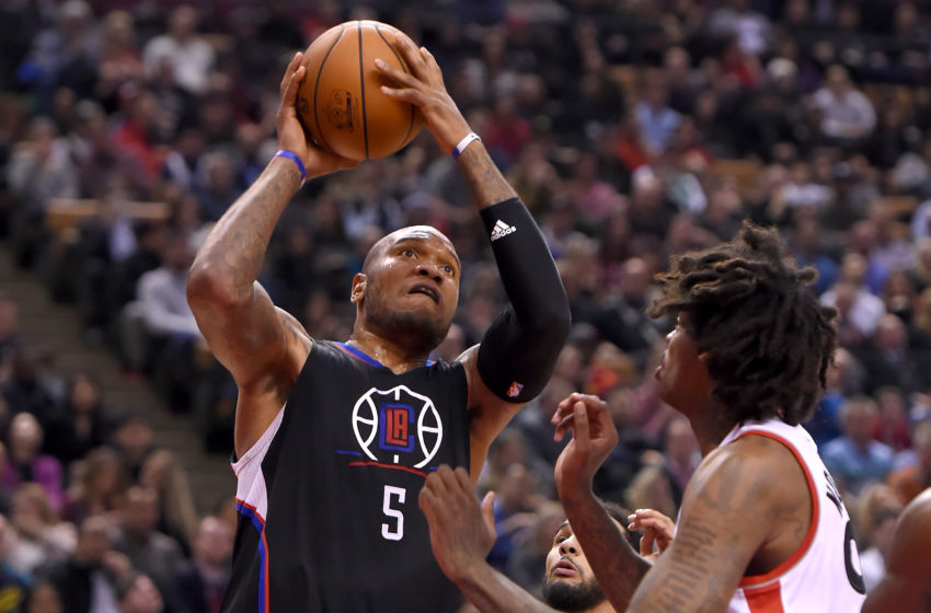 Feb 6, 2017; Toronto, Ontario, CAN; Los Angeles Clippers forward Marreese Speights (5) shoots for a basket past Toronto Raptors center Lucas Nogueira (92) in the second half at Air Canada Centre. Mandatory Credit: Dan Hamilton-USA TODAY Sports
