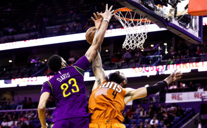 Feb 6, 2017; New Orleans, LA, USA; New Orleans Pelicans forward Anthony Davis (23) blocks a shot by Phoenix Suns center Tyson Chandler (4) during the second half at the Smoothie King Center. The Pelicans won 111-106. Mandatory Credit: Derick E. Hingle-USA TODAY Sports