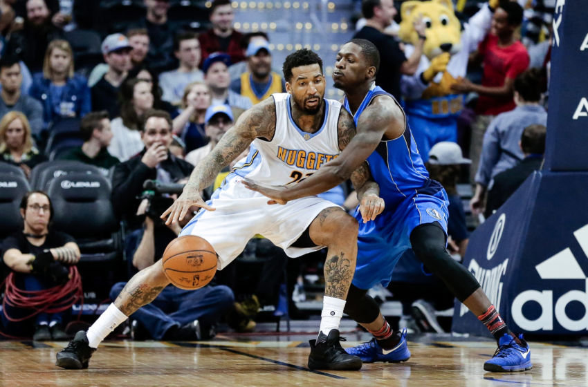 Feb 6, 2017; Denver, CO, USA; Denver Nuggets forward Wilson Chandler (21) looks to pass the ball as Dallas Mavericks forward Dorian Finney-Smith (10) defends in the third quarter at the Pepsi Center. The Nuggets won 110-87. Mandatory Credit: Isaiah J. Downing-USA TODAY Sports