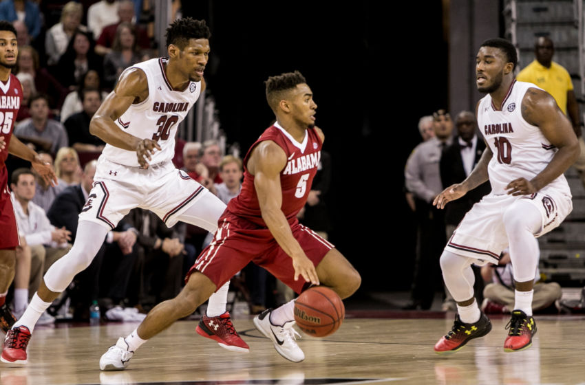 Feb 7, 2017; Columbia, SC, USA; Alabama Crimson Tide guard Avery Johnson Jr. (5) drives past South Carolina Gamecocks forward Chris Silva (30) and South Carolina Gamecocks guard Duane Notice (10) in the quadruple overtime game at Colonial Life Arena. The Alabama Crimson Tide won 90-86. Mandatory Credit: Jeff Blake-USA TODAY Sports