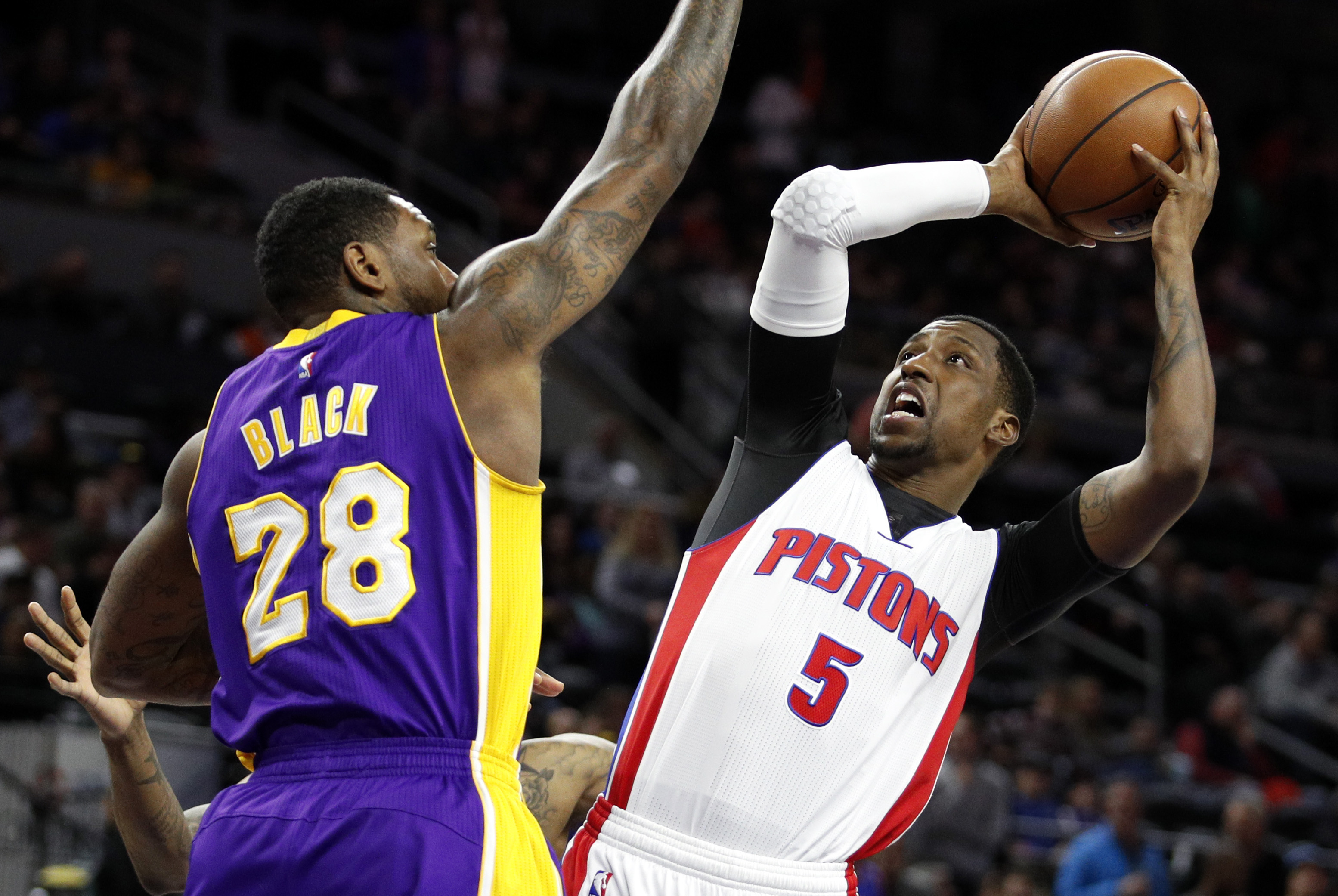 Feb 8, 2017; Auburn Hills, MI, USA; Detroit Pistons guard Kentavious Caldwell-Pope (5) attempts a shot against Los Angeles Lakers center Tarik Black (28) during the first quarter at The Palace of Auburn Hills. Mandatory Credit: Raj Mehta-USA TODAY Sports