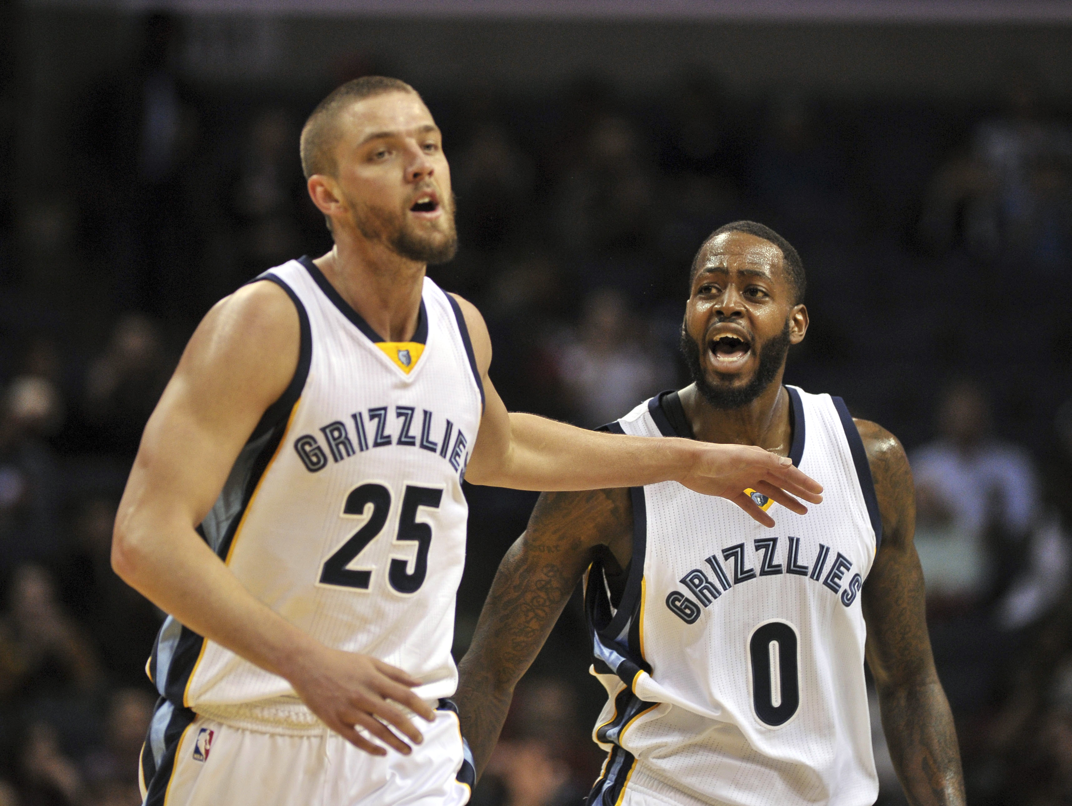 Feb 8, 2017; Memphis, TN, USA; Memphis Grizzlies forward Chandler Parsons (25) and Memphis Grizzlies forward JaMychal Green (0) celebrate during the first half against the Phoenix Suns at FedExForum. Mandatory Credit: Justin Ford-USA TODAY Sports