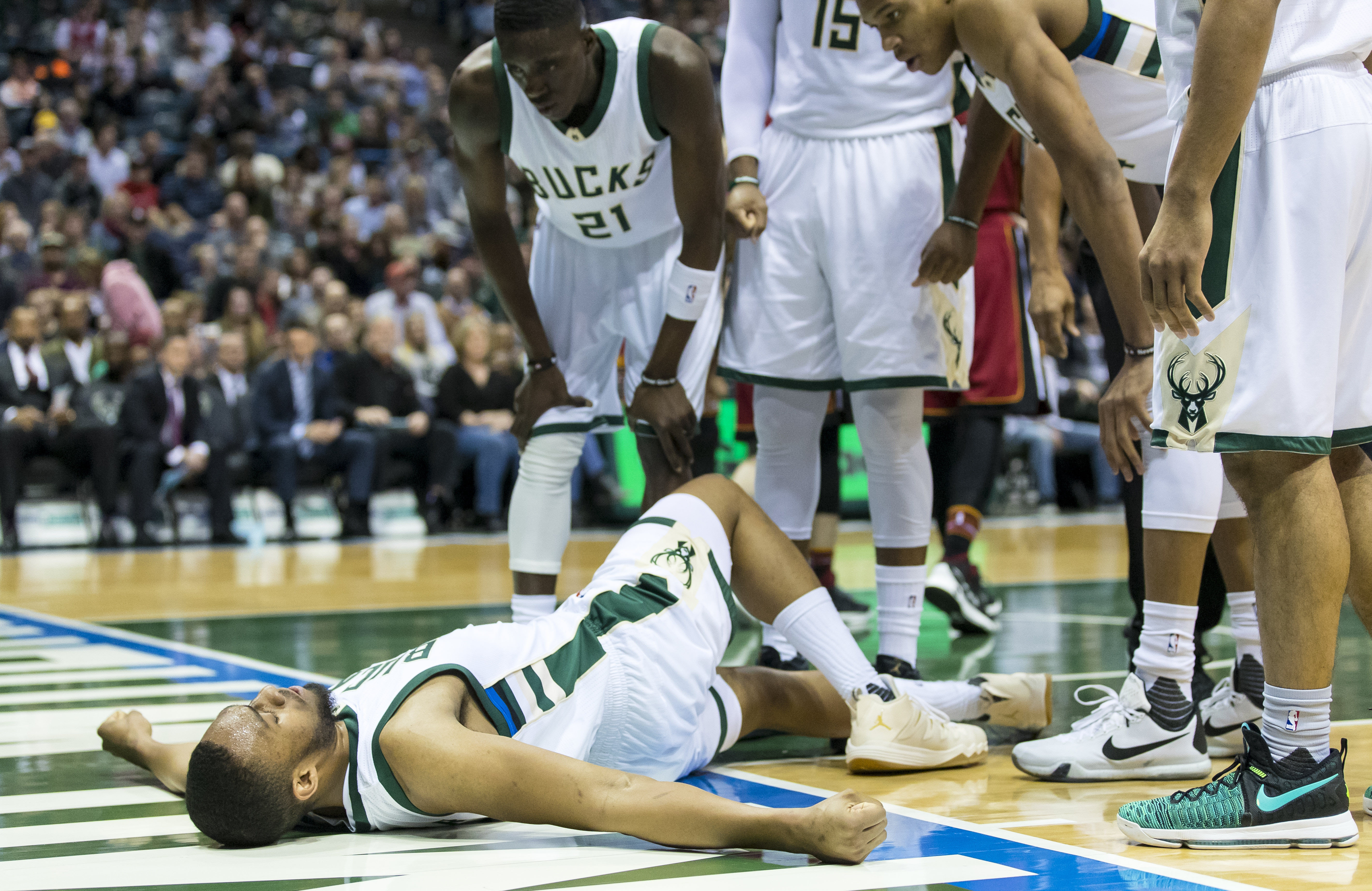 Feb 8, 2017; Milwaukee, WI, USA; Milwaukee Bucks forward Jabari Parker (12) lays on the court surrounded by teammates after being injured during the third quarter against the Miami Heat at BMO Harris Bradley Center. Mandatory Credit: Jeff Hanisch-USA TODAY Sports