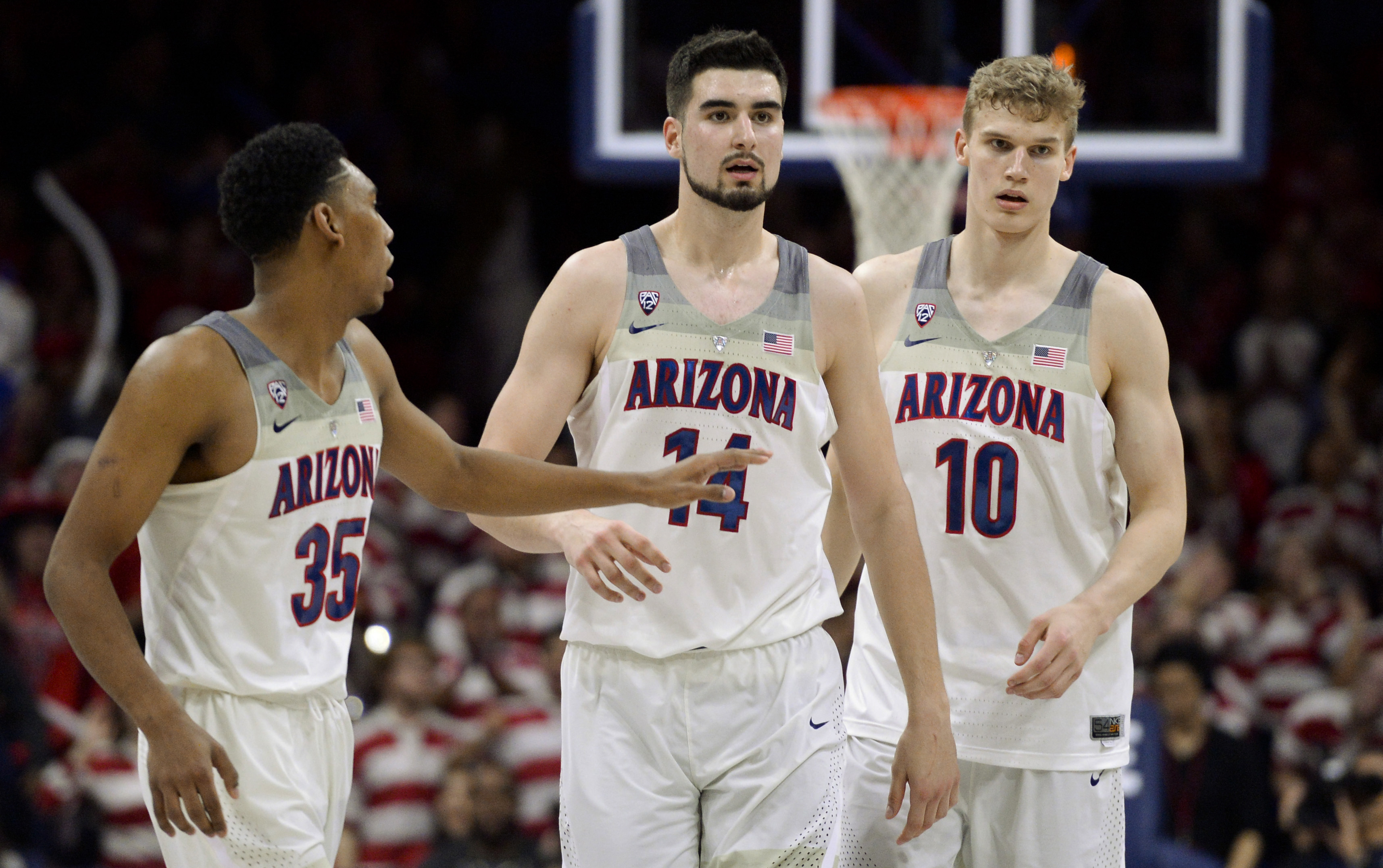 Feb 8, 2017; Tucson, AZ, USA; Arizona Wildcats guard Allonzo Trier (35) and center Dusan Ristic (14) and forward Lauri Markkanen (10) walk up court during the second half against the Stanford Cardinal at McKale Center. Arizona won 74-67. Mandatory Credit: Casey Sapio-USA TODAY Sports