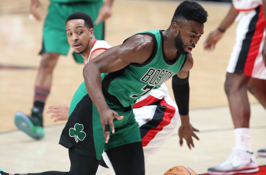 Feb 9, 2017; Portland, OR, USA; Boston Celtics forward Jaylen Brown (7) spins around Portland Trail Blazers guard C.J. McCollum (3) in the first half at Moda Center. Mandatory Credit: Jaime Valdez-USA TODAY Sports
