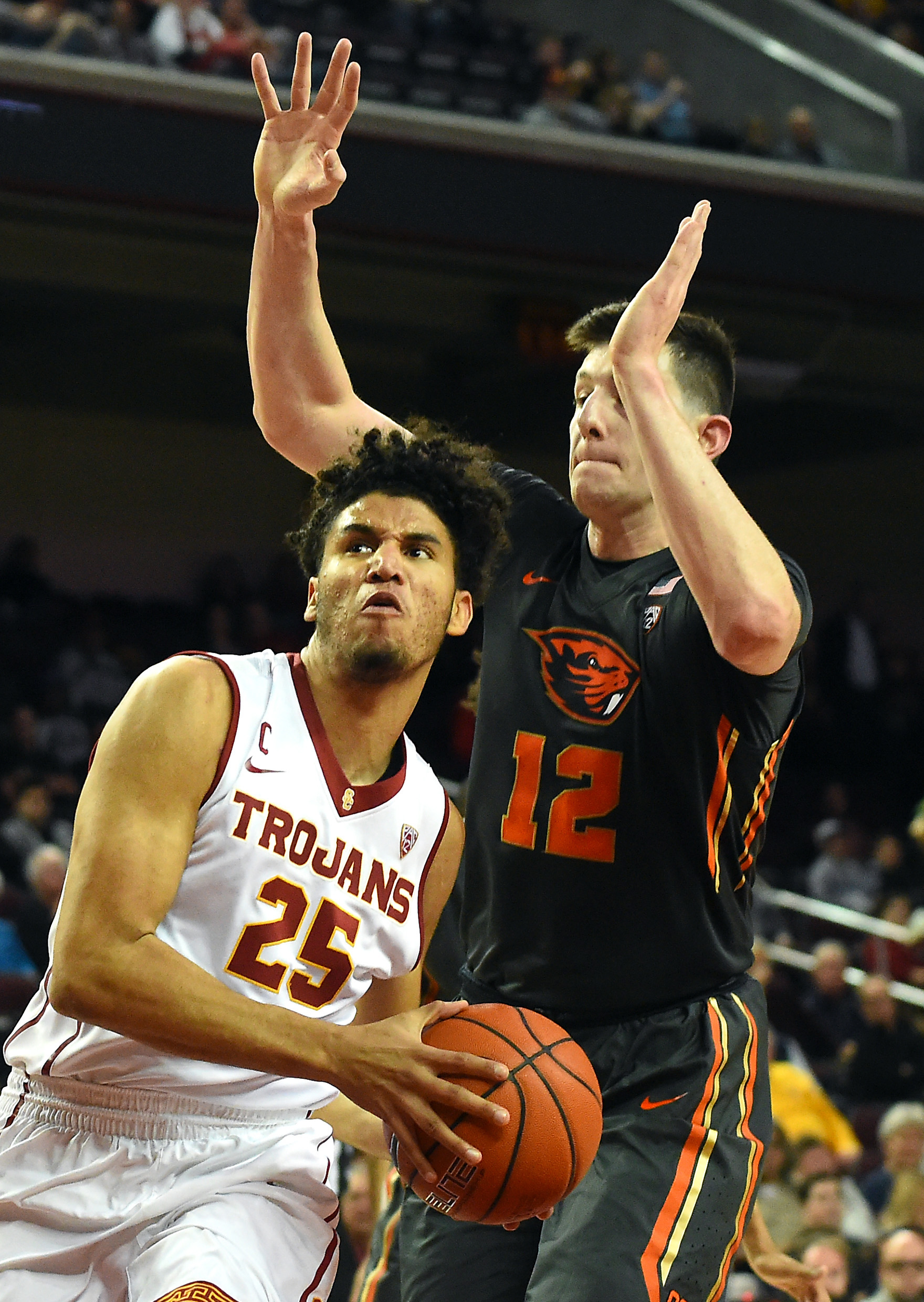 Feb 9, 2017; Los Angeles, CA, USA; Oregon State Beavers forward Drew Eubanks (12) guards USC Trojans forward Bennie Boatwright (25) as he drives to the basket in the first half of the game at Galen Center. Mandatory Credit: Jayne Kamin-Oncea-USA TODAY Sports