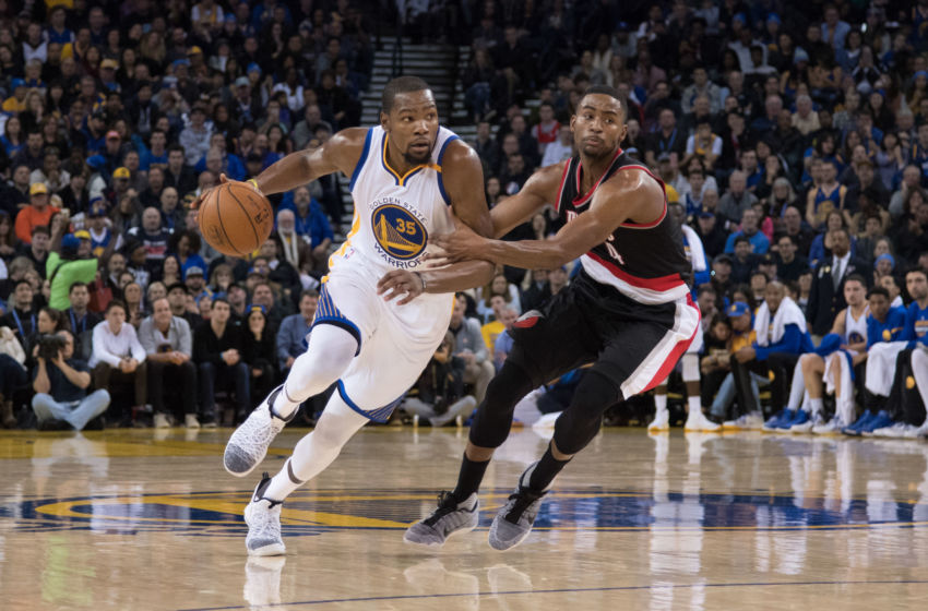 January 4, 2017; Oakland, CA, USA; Golden State Warriors forward Kevin Durant (35) dribbles the basketball against Portland Trail Blazers forward Maurice Harkless (4) during the third quarter at Oracle Arena. The Warriors defeated the Trail Blazers 125-117. Mandatory Credit: Kyle Terada-USA TODAY Sports