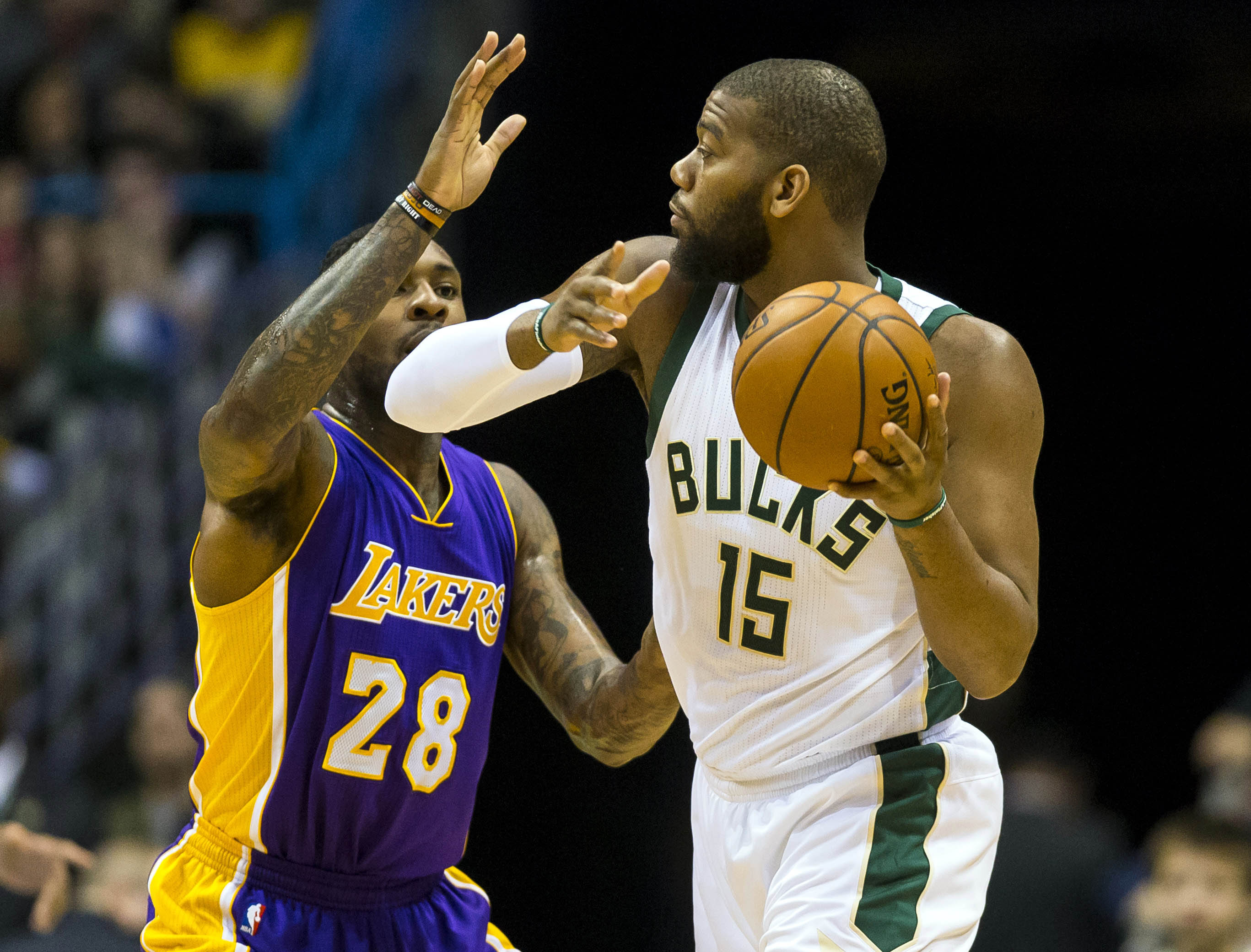 Feb 10, 2017; Milwaukee, WI, USA; Milwaukee Bucks center Greg Monroe (15) looks to pass the ball under pressure from Los Angeles Lakers center Tarik Black (28) during the first quarter at BMO Harris Bradley Center. Mandatory Credit: Jeff Hanisch-USA TODAY Sports