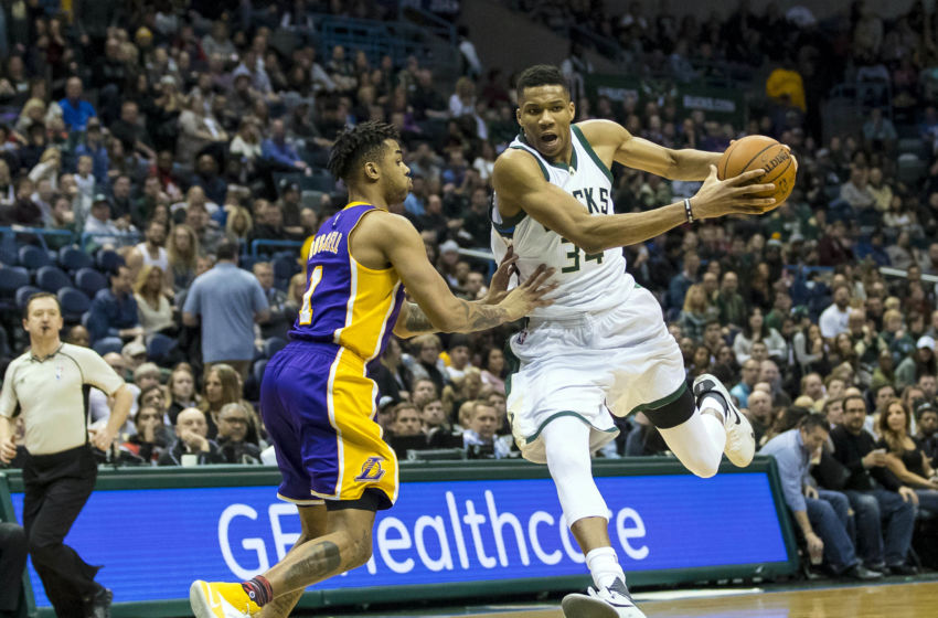 Feb 10, 2017; Milwaukee, WI, USA; Milwaukee Bucks forward Giannis Antetokounmpo (34) drives for the basket as Los Angeles Lakers guard D'Angelo Russell (1) defends during the third quarter at BMO Harris Bradley Center. Mandatory Credit: Jeff Hanisch-USA TODAY Sports