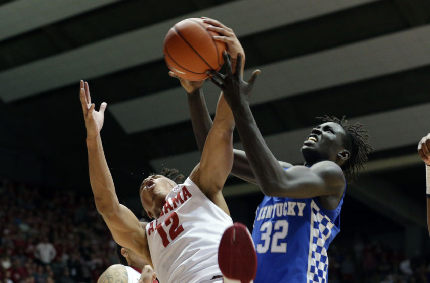 Feb 11, 2017; Tuscaloosa, AL, USA; Kentucky Wildcats forward Wenyen Gabriel (32) goes for a rebound along with Alabama Crimson Tide guard Dazon Ingram (12) during the first half at Coleman Coliseum. Mandatory Credit: Marvin Gentry-USA TODAY Sports