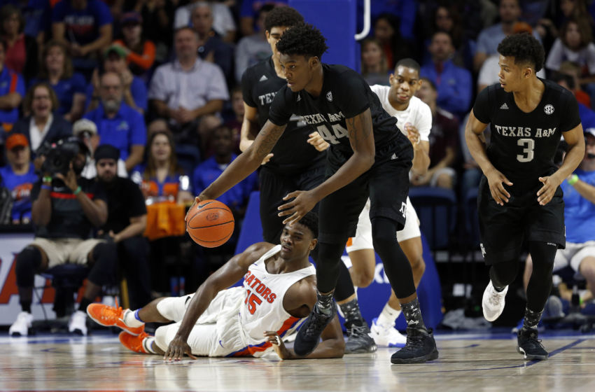 Feb 11, 2017; Gainesville, FL, USA; Florida Gators center John Egbunu (15) turns the ball over to Texas A&M Aggies forward Robert Williams (44)  during the second half at Exactech Arena at the Stephen C. O'Connell Center. The Gators won 71-62. Mandatory Credit: Kim Klement-USA TODAY Sports