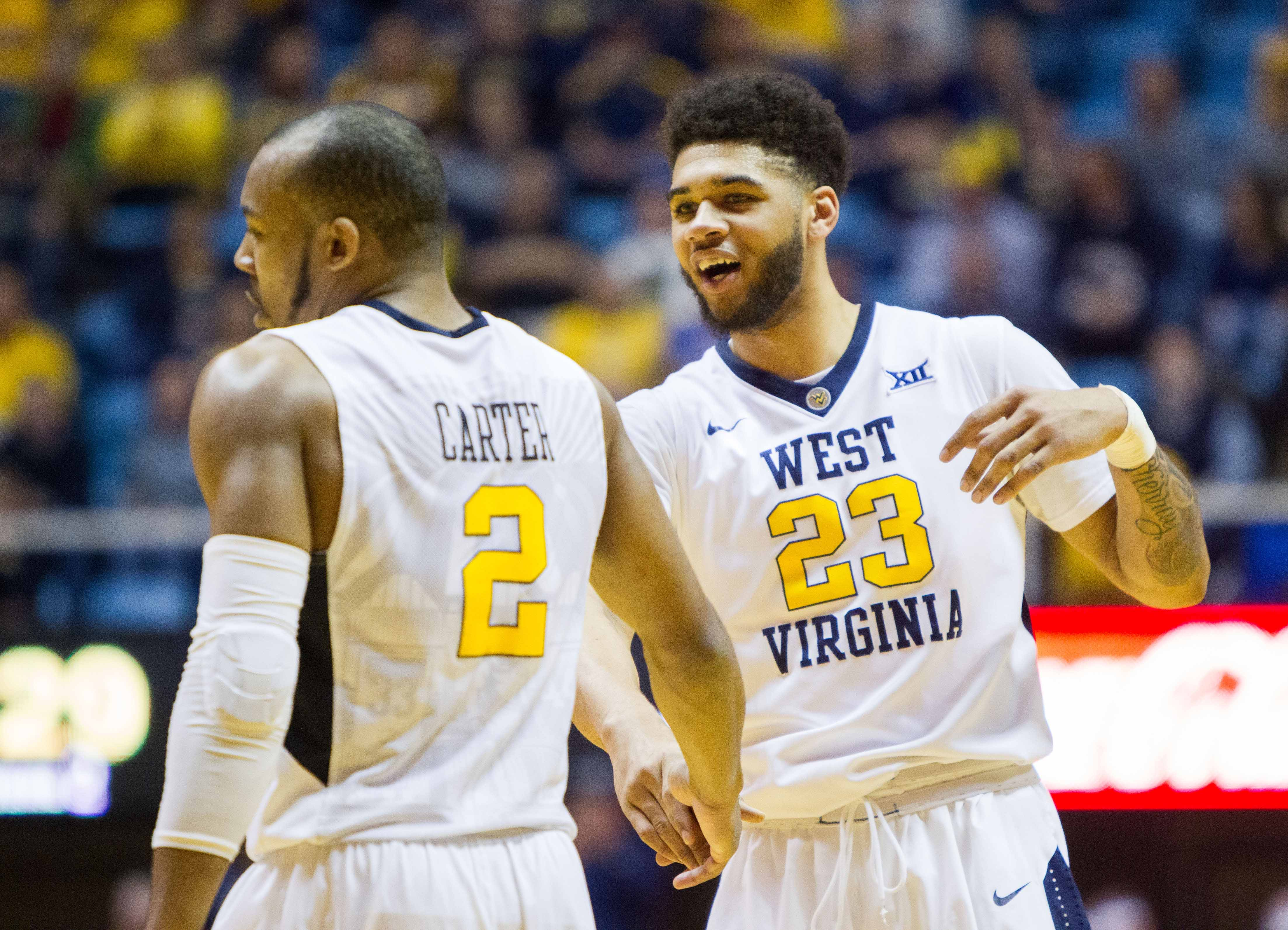 Feb 11, 2017; Morgantown, WV, USA; West Virginia Mountaineers forward Esa Ahmad (23) and guard Jevon Carter (2) celebrate during the second half against the Kansas State Wildcats at WVU Coliseum. Mandatory Credit: Ben Queen-USA TODAY Sports