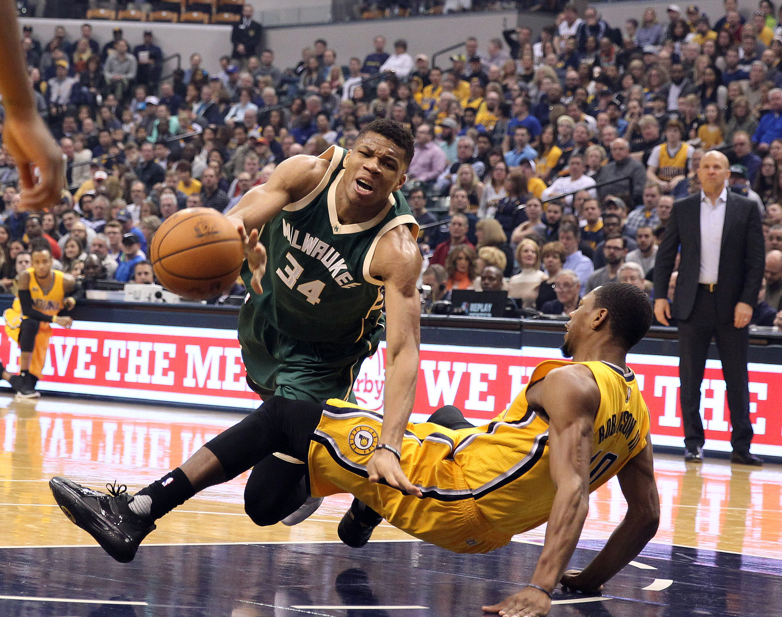 Feb 11, 2017; Indianapolis, IN, USA; Milwaukee Bucks forward Giannis Antetokounmpo (34) draws a blocking foul against Indiana Pacers forward Glenn Robinson III (40) at Bankers Life Fieldhouse. Mandatory Credit: Brian Spurlock-USA TODAY Sports