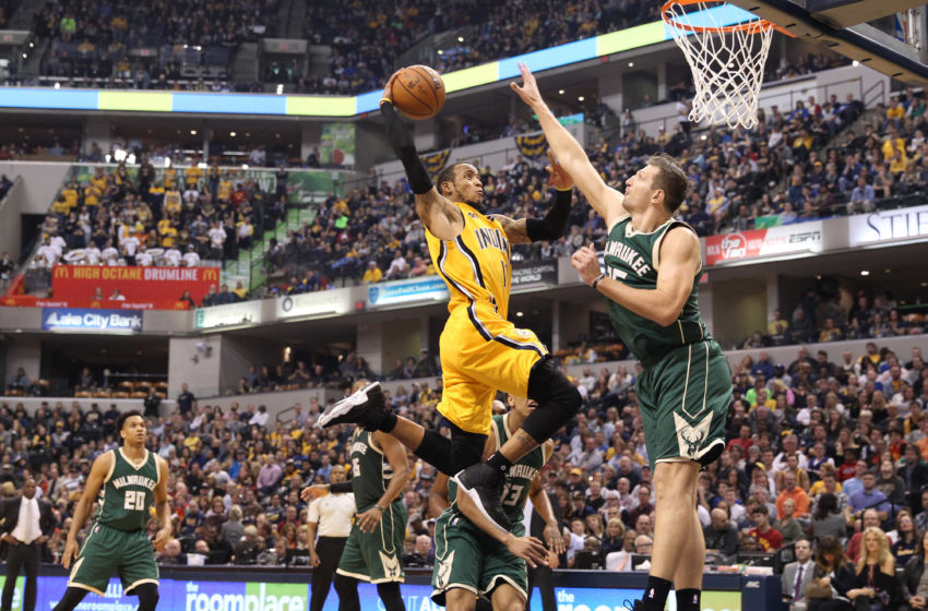 Feb 11, 2017; Indianapolis, IN, USA; Indiana Pacers guard Monta Ellis (11) dunks against Milwaukee Bucks forward Mirza Teletovic (35) at Bankers Life Fieldhouse. Milwaukee defeats Indiana 116-100. Mandatory Credit: Brian Spurlock-USA TODAY Sports