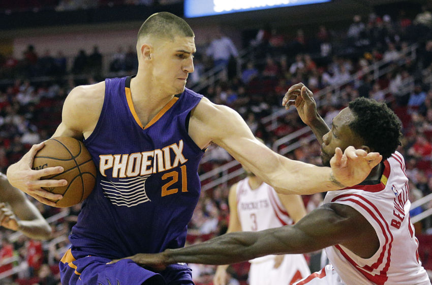 Feb 11, 2017; Houston, TX, USA; Phoenix Suns center Alex Len (21) fouls Houston Rockets guard Patrick Beverley (2) in the second half at Toyota Center. Houston Rockets won 133 to 102 .Mandatory Credit: Thomas B. Shea-USA TODAY Sports