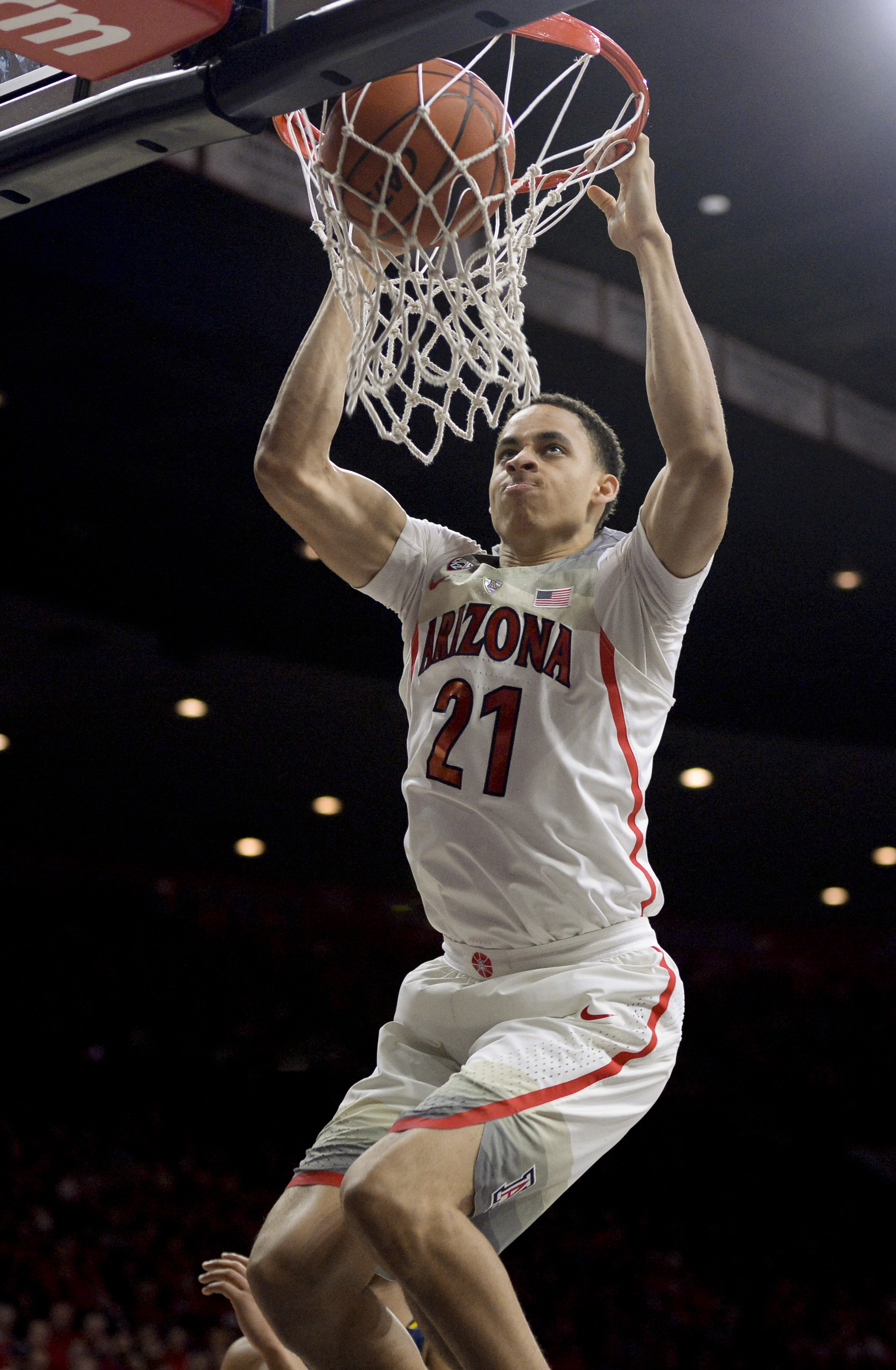 Feb 11, 2017; Tucson, AZ, USA; Arizona Wildcats center Chance Comanche (21) dunks the ball during the second half against the California Golden Bears at McKale Center. Arizona won 62-57. Mandatory Credit: Casey Sapio-USA TODAY Sports