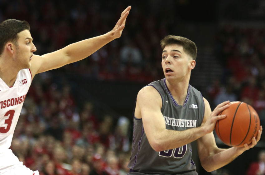 Feb 12, 2017; Madison, WI, USA; Northwestern Wildcats guard Bryant McIntosh looks to pass over Wisconsin Badgers guard Zak Showalter (3) at the Kohl Center. Mandatory Credit: Mary Langenfeld-USA TODAY Sports