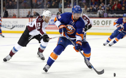 Feb 12, 2017; Brooklyn, NY, USA; New York Islanders center Brock Nelson (29) controls the puck against Colorado Avalanche center Mikhail Grigorenko (25) during the second period at Barclays Center. Mandatory Credit: Brad Penner-USA TODAY Sports