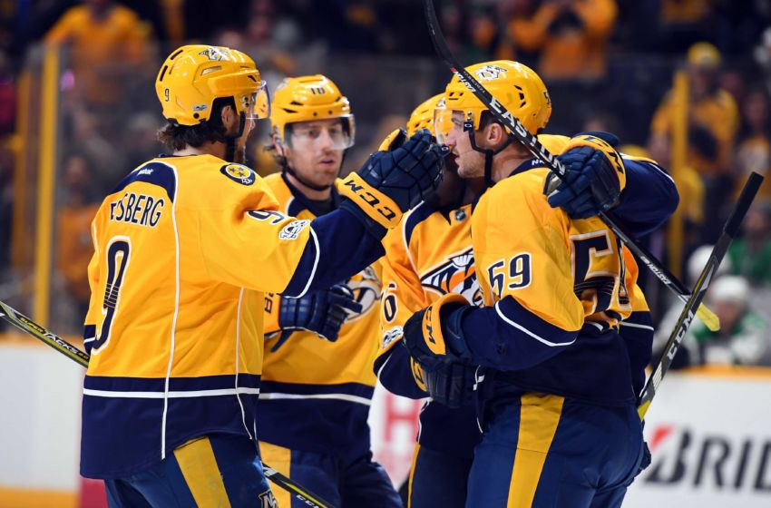 Feb 12, 2017; Nashville, TN, USA; Nashville Predators players celebrate after a goal by defenseman Roman Josi (59) during the third period against the Dallas Stars at Bridgestone Arena. Mandatory Credit: Christopher Hanewinckel-USA TODAY Sports