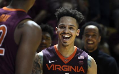 Feb 12, 2017; Blacksburg, VA, USA; Virginia Tech Hokies guard Seth Allen (4) reacts following a made basket against the Virginia Cavaliers at Cassell Coliseum. Mandatory Credit: Michael Shroyer-USA TODAY Sports