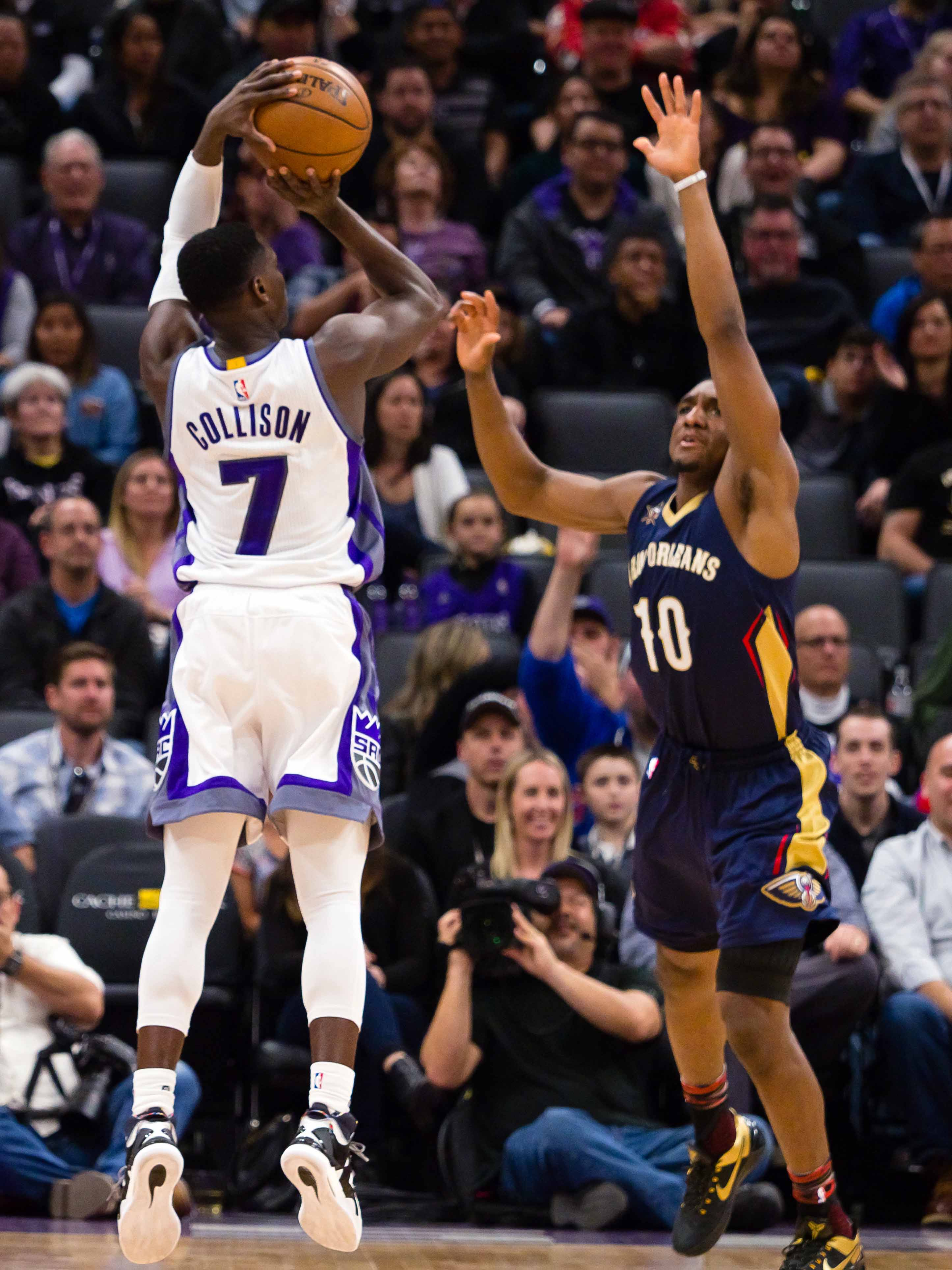 Feb 12, 2017; Sacramento, CA, USA; Sacramento Kings guard Darren Collison (7) scores against New Orleans Pelicans guard Langston Galloway (10) during the second quarter at Golden 1 Center. Mandatory Credit: Kelley L Cox-USA TODAY Sports