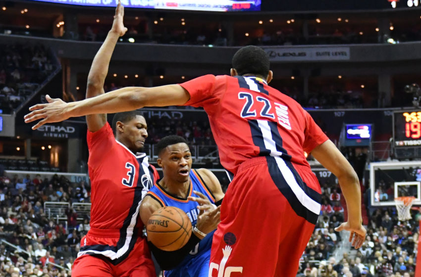 Feb 13, 2017; Washington, DC, USA; Oklahoma City Thunder guard Russell Westbrook (0) looks to pass as Washington Wizards guard Bradley Beal (3) and forward Otto Porter Jr. (22) defend during the first quarter at Verizon Center. Mandatory Credit: Tommy Gilligan-USA TODAY Sports
