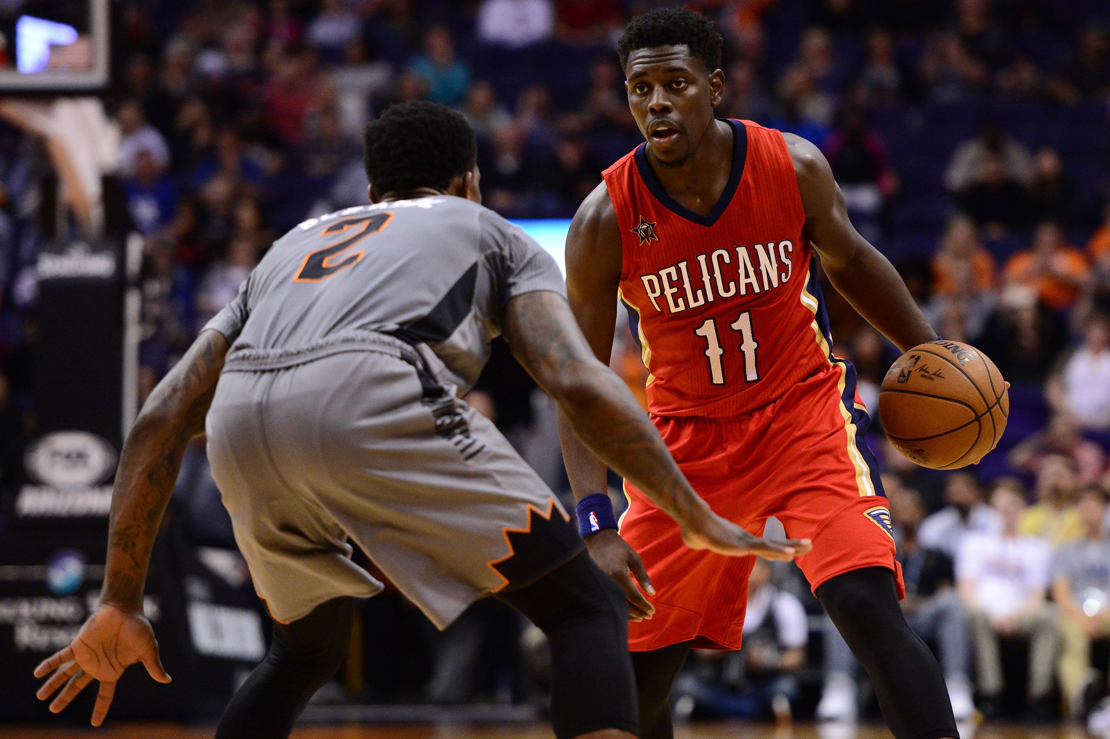 Feb 13, 2017; Phoenix, AZ, USA; New Orleans Pelicans Guard Jrue Holiday  (11) Handles The Ball Against Phoenix Suns Guard Eric Bledsoe (2) In The  Second Half ...