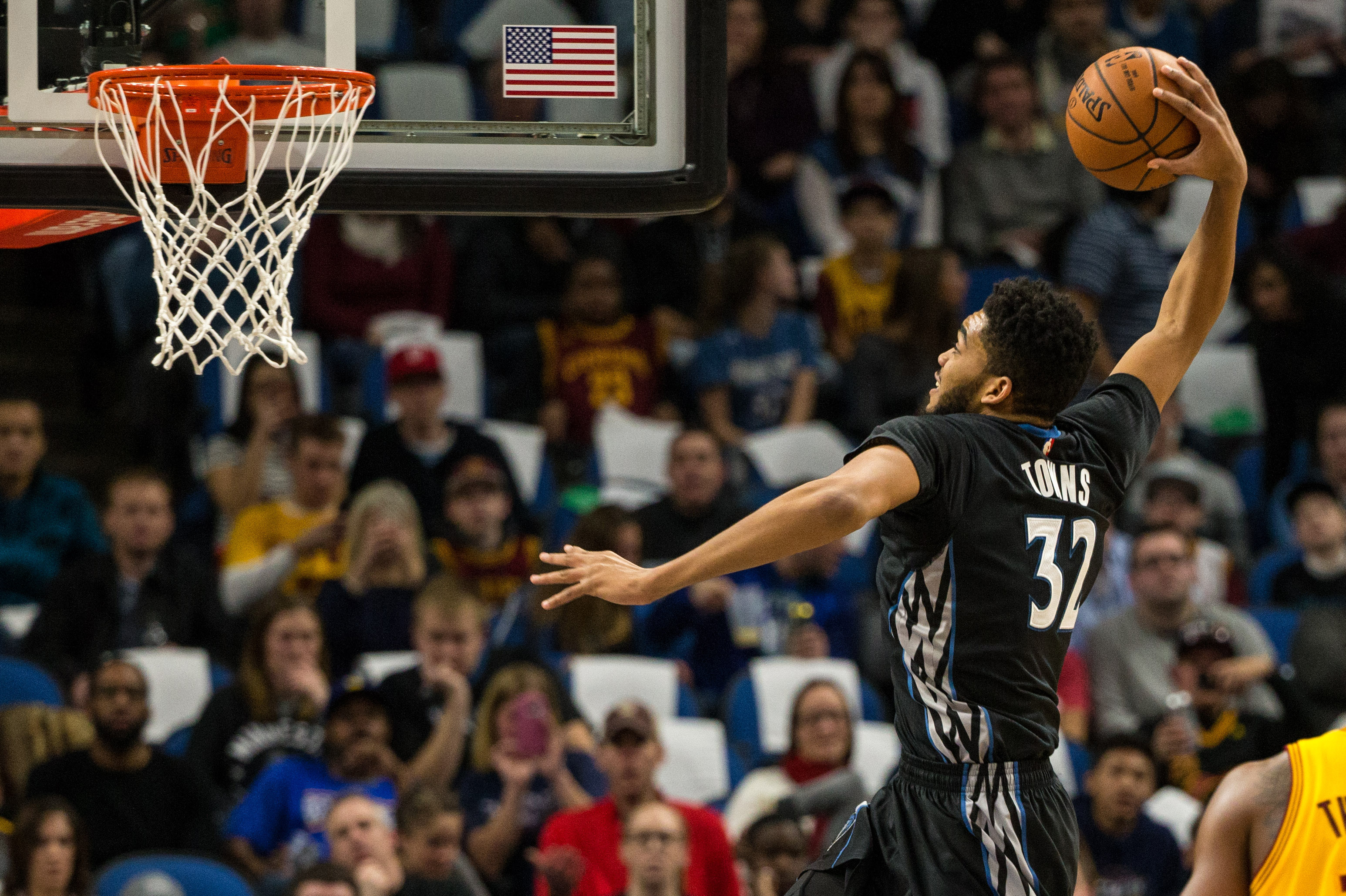 Feb 14, 2017; Minneapolis, MN, USA; Minnesota Timberwolves forward Karl-Anthony Towns (32) dunks during the first quarter against the Cleveland Cavaliers at Target Center. Mandatory Credit: Brace Hemmelgarn-USA TODAY Sports