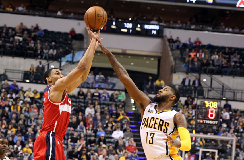 Feb 16, 2017; Indianapolis, IN, USA; Washington Wizards forward Otto Porter (22) takes a shot against Indiana Pacers forward Paul George (13) at Bankers Life Fieldhouse. Mandatory Credit: Brian Spurlock-USA TODAY Sports