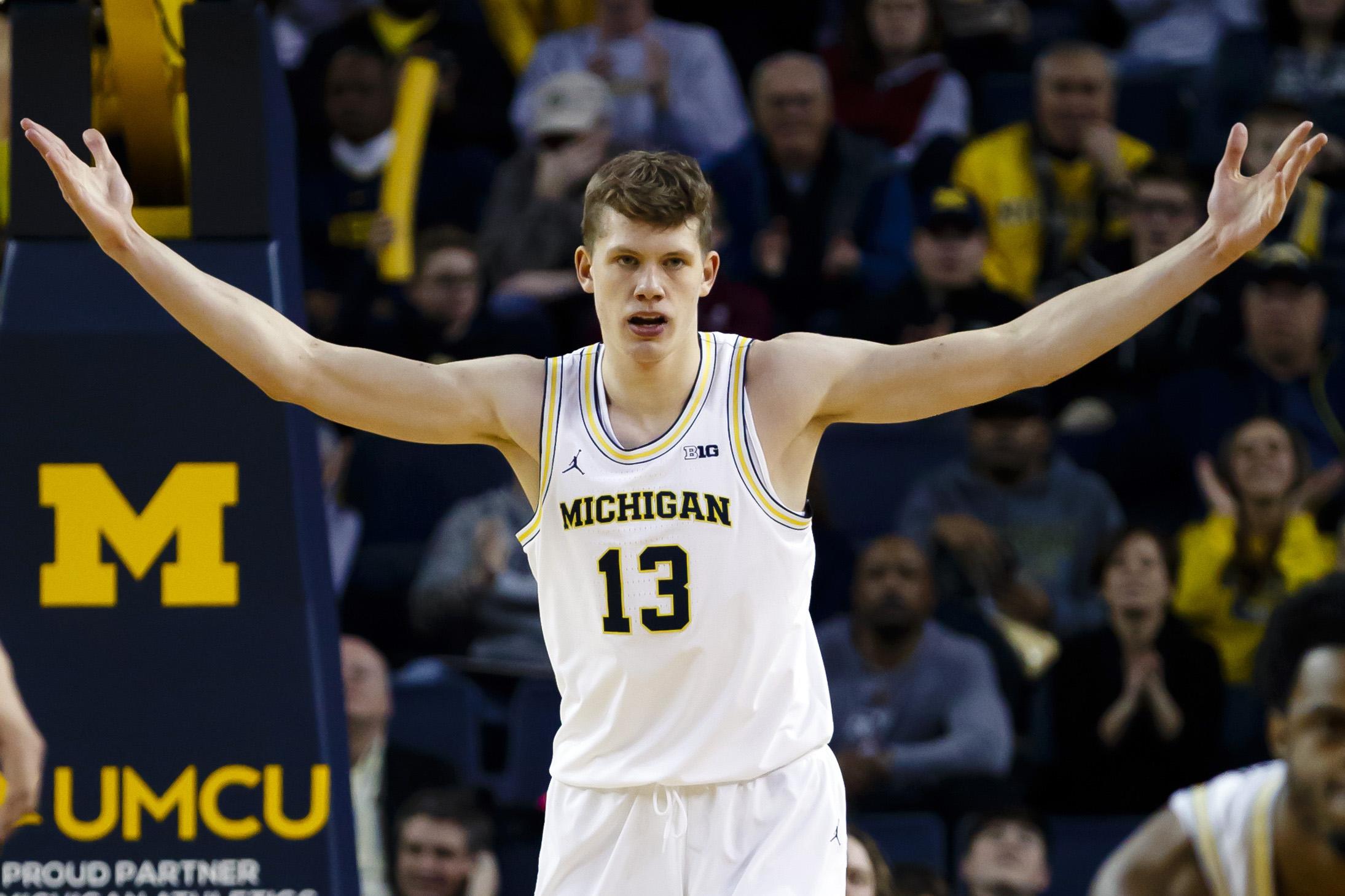 Michigan Basketball: Zak Irvin, Mo Wagner breathe easy in ...