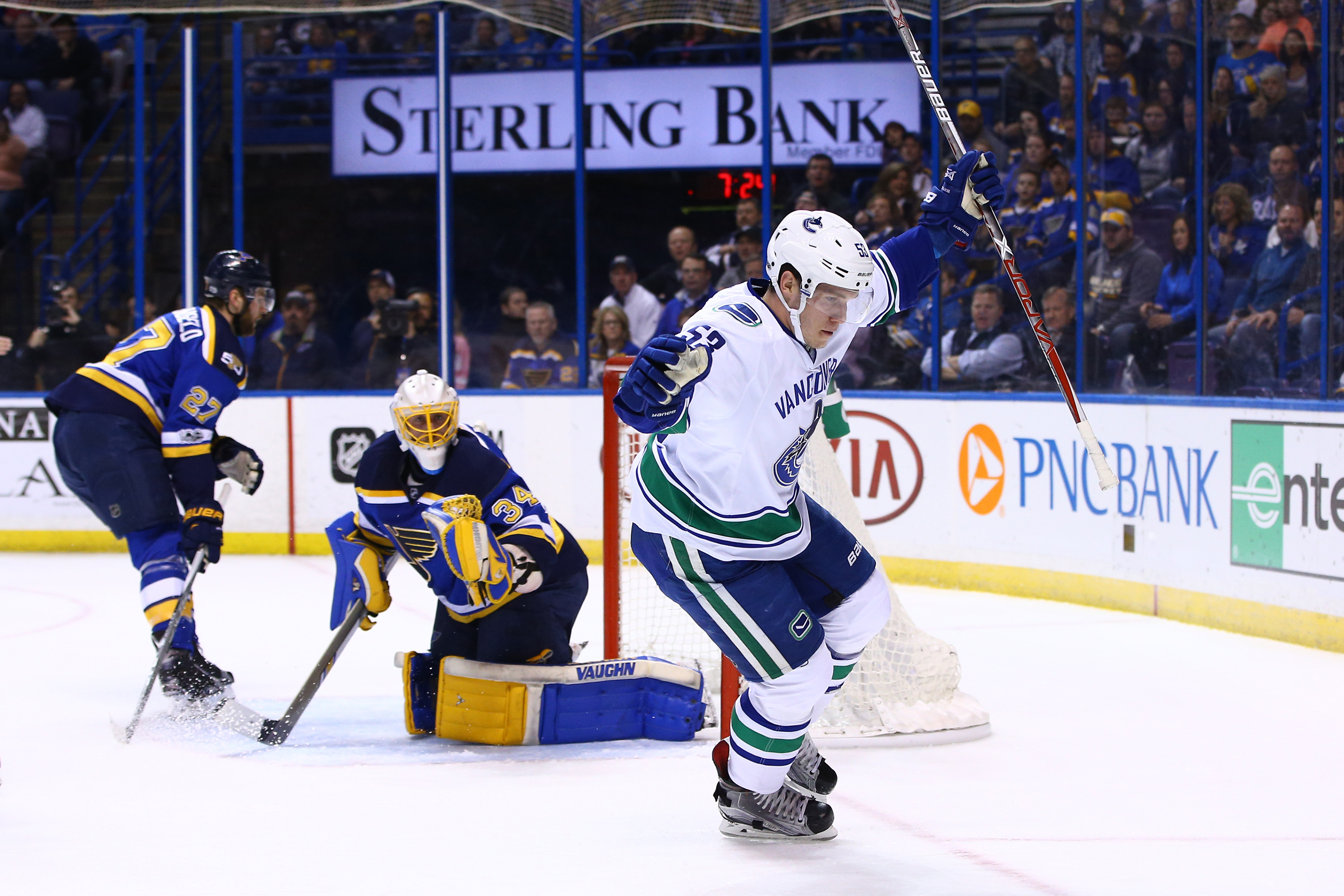 9881236-nhl-vancouver-canucks-at-st.-louis-blues-1