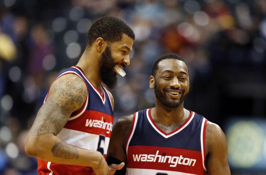 Feb 16, 2017; Indianapolis, IN, USA; Washington Wizards forward Markieff Morris (5) shakes hands with guard John Wall (2) after defeating the Indiana Pacers at Bankers Life Fieldhouse. Washington defeats Indiana 111-98. Mandatory Credit: Brian Spurlock-USA TODAY Sports