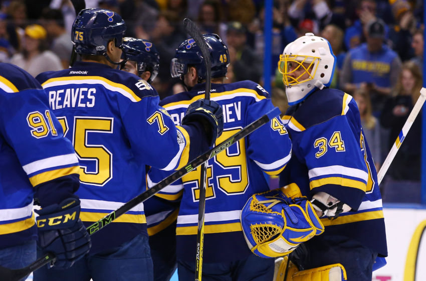 Feb 16, 2017; St. Louis, MO, USA; St. Louis Blues goalie Jake Allen (34) is congratulated by teammates after the Blues defeat the Vancouver Canucks 4-3 at Scottrade Center. Mandatory Credit: Billy Hurst-USA TODAY Sports